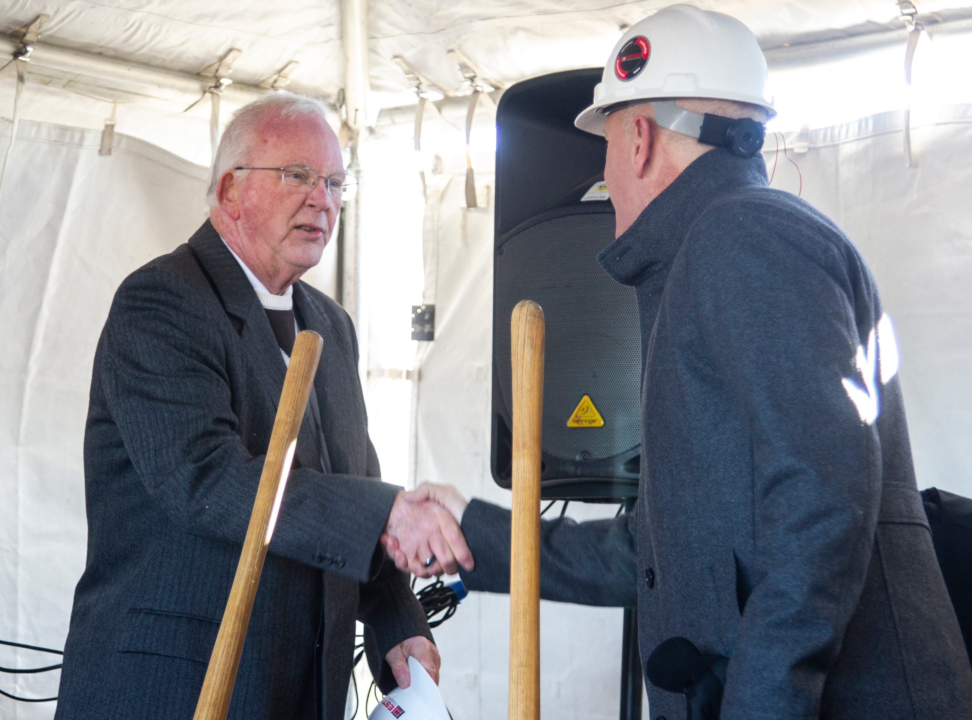 North Liberty Mayor Terry Donahue shakes hands with Estes Construction contractor Kent Pilcher during a groundbreaking event for a new Diventures store location on Thursday, Jan. 3, 2019, at the 1895 West Penn Street in North Liberty, Iowa.