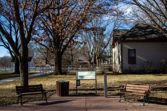 An informational board and seating area is seen on Thursday, Jan. 3, 2019, at the Herbert Hoover National Historic Site in West Branch, Iowa.