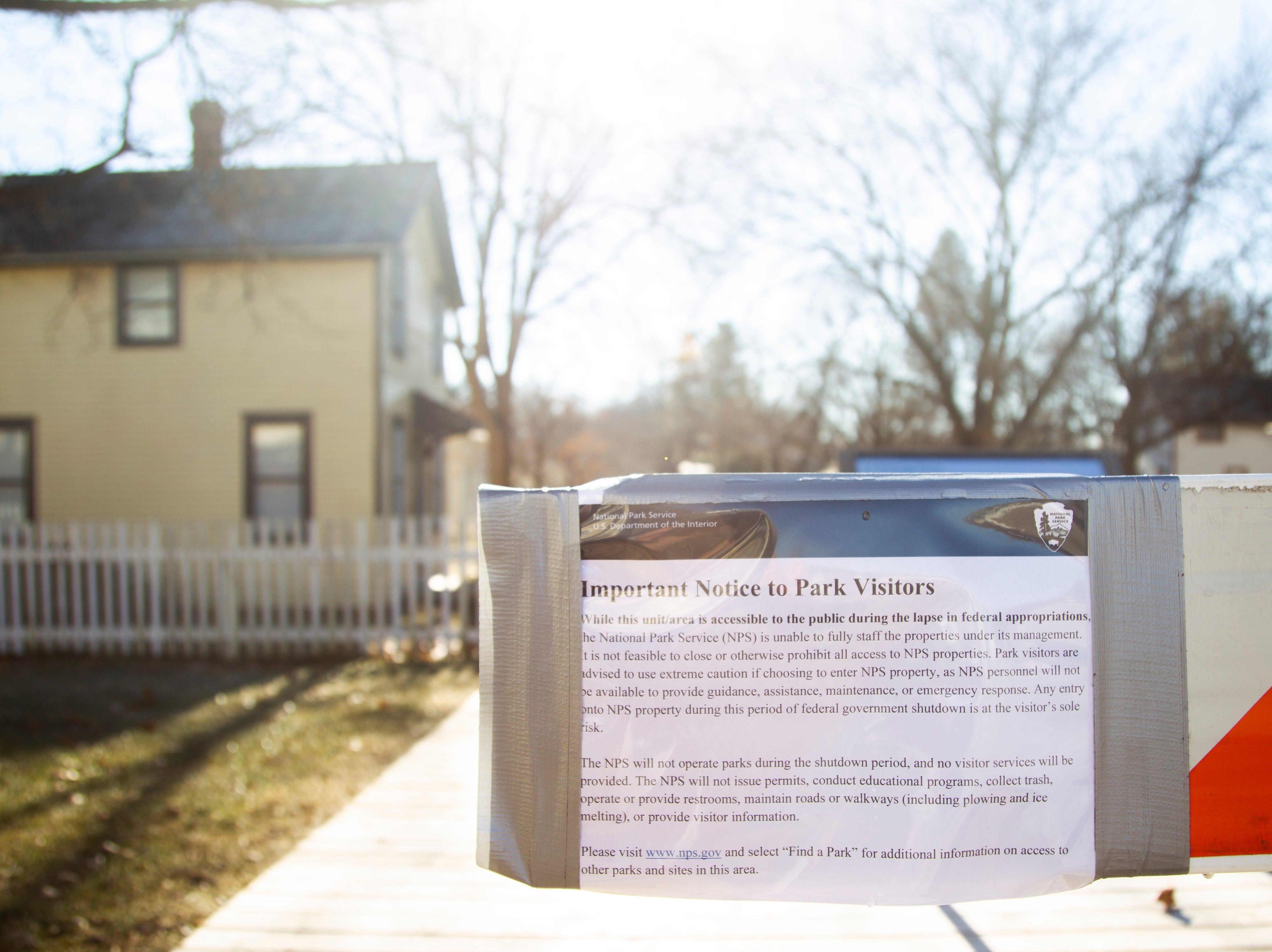A notice from the National Parks Service is posted on a barrier about the government shutdown on Thursday, Jan. 3, 2019, at the Herbert Hoover National Historic Site in West Branch, Iowa.
