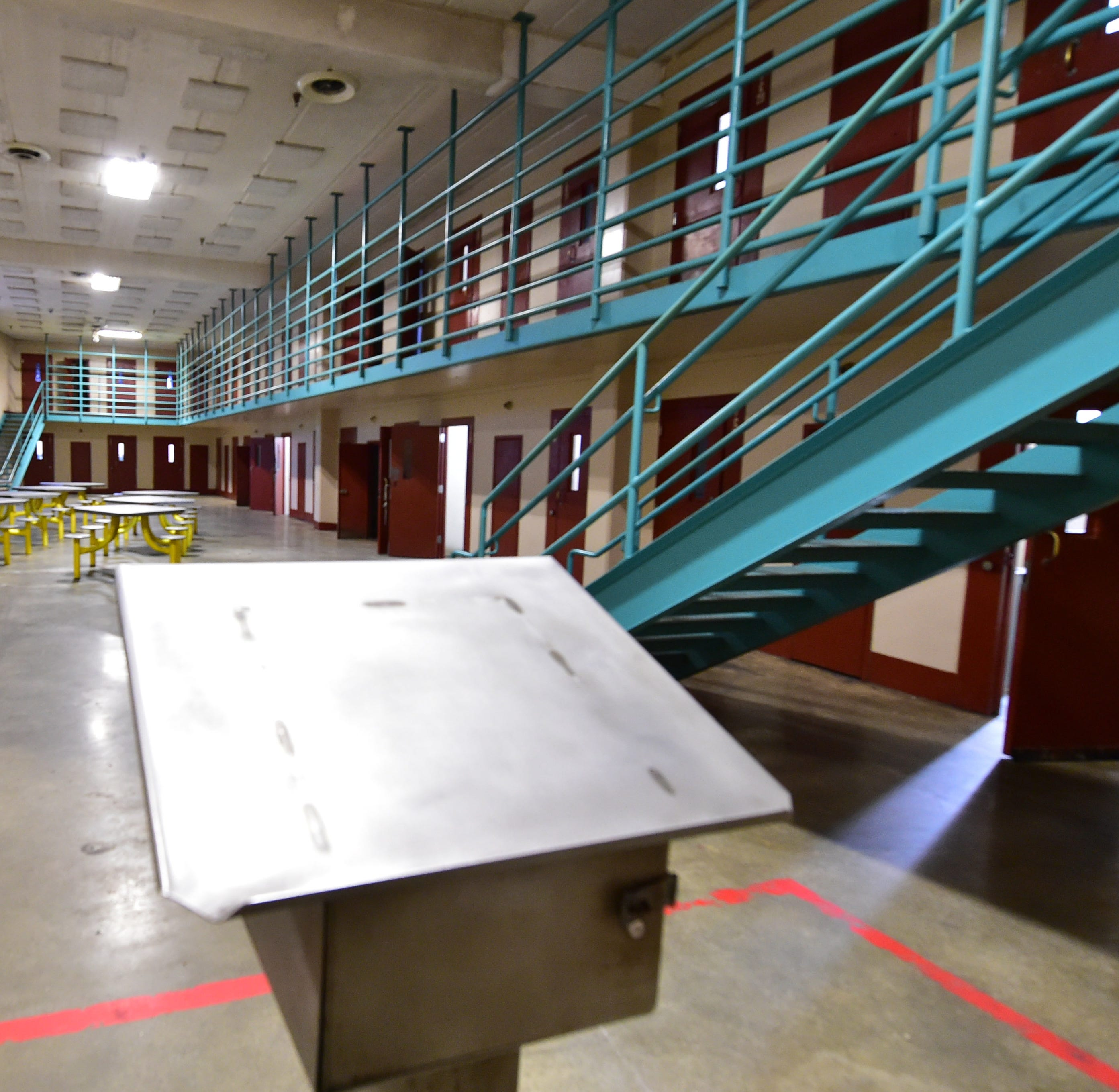 A guard's stand in a cell block of Walnut Grove Correctional Facility remains empty without inmates to look after. While the state closed the facility in 2016, Mississippi taxpayers are still paying the $97.4 million the state still owes on the facility and related services. Thursday, Dec. 20, 2018