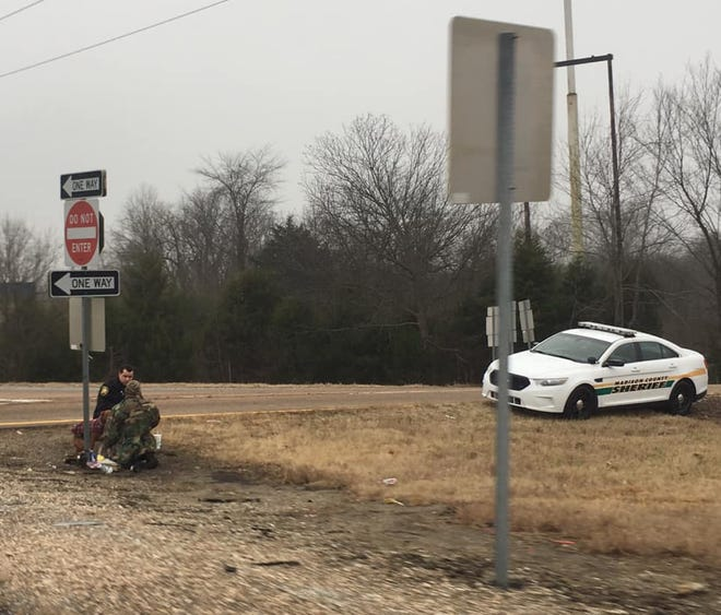 Elizabeth McClain posted this photo on her Facebook page of Madison County Sheriff Deputy William Haley having lunch with a homeless man in Jackson off Interstate 40 on Wednesday, Jan. 2, 2019.
