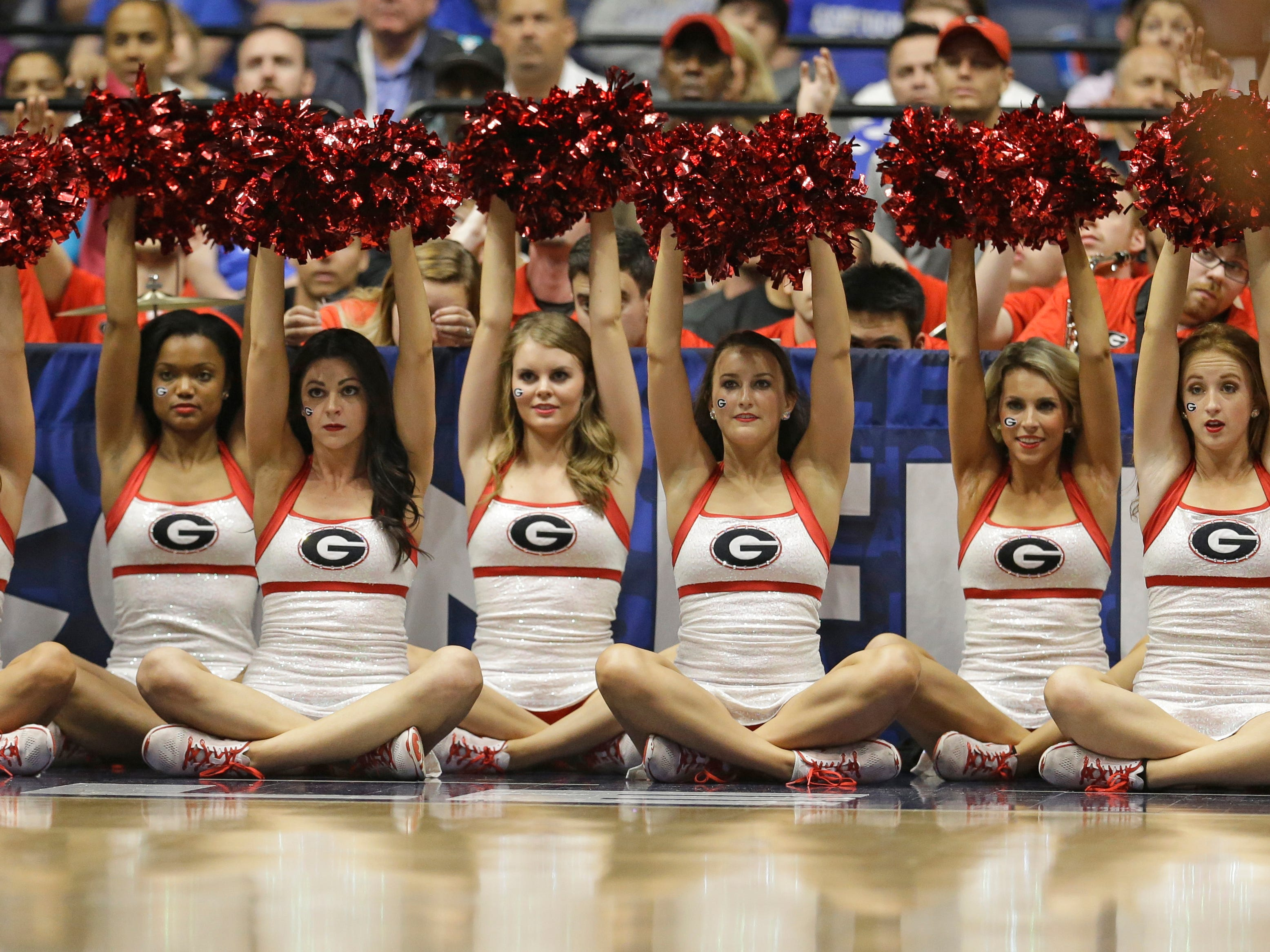 Georgia cheerleaders perform during the first half of an NCAA college basketball game against Kentucky in the Southeastern Conference tournament in Nashville, Tenn., Saturday, March 12, 2016. (AP Photo/Mark Humphrey)