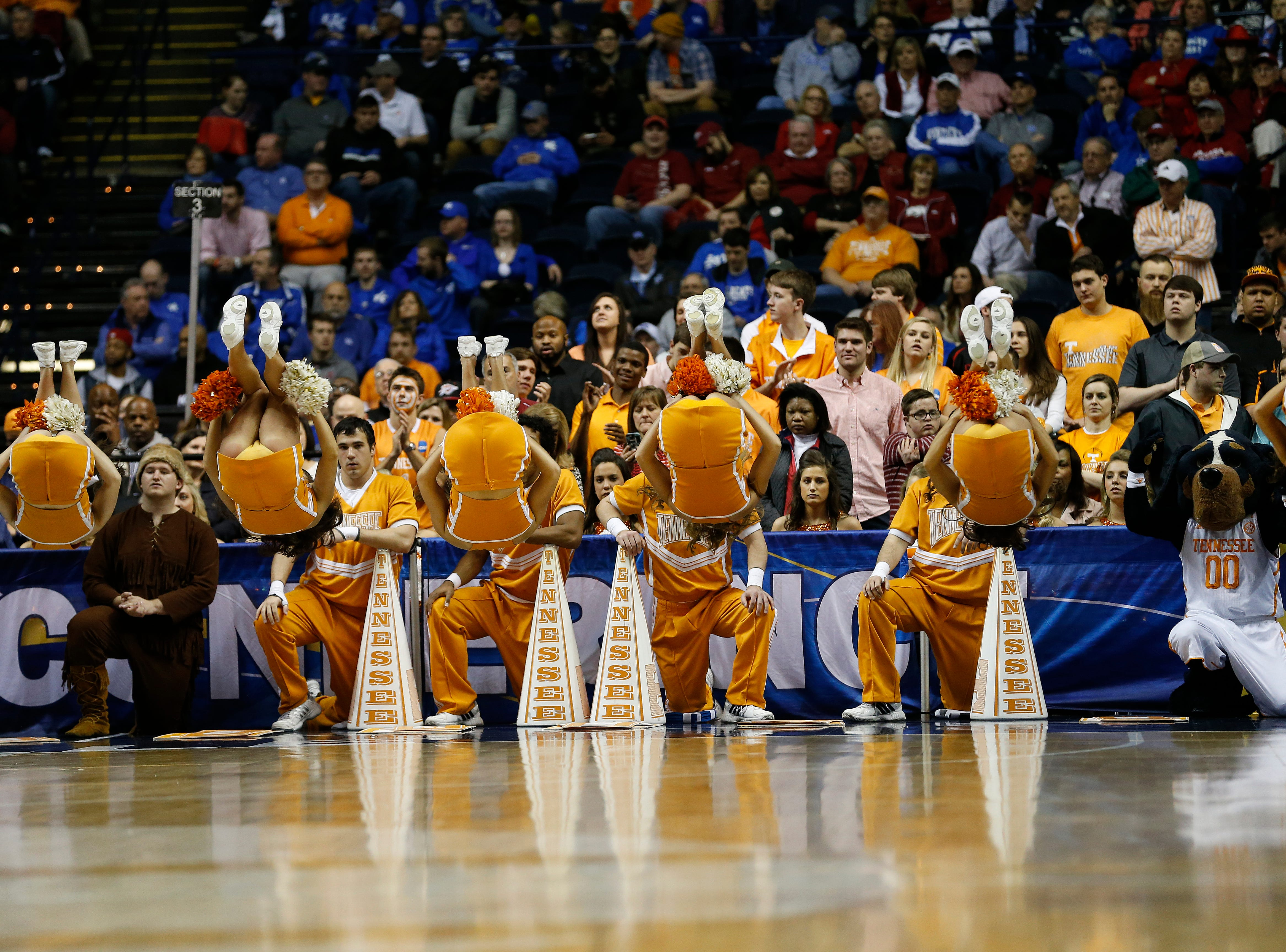 Tennessee cheerleaders perform during the first half of an NCAA college basketball game in the quarterfinal round of the Southeastern Conference tournament between Arkansas and Tennessee, Friday, March 13, 2015, in Nashville, Tenn. (AP Photo/Steve Helber)