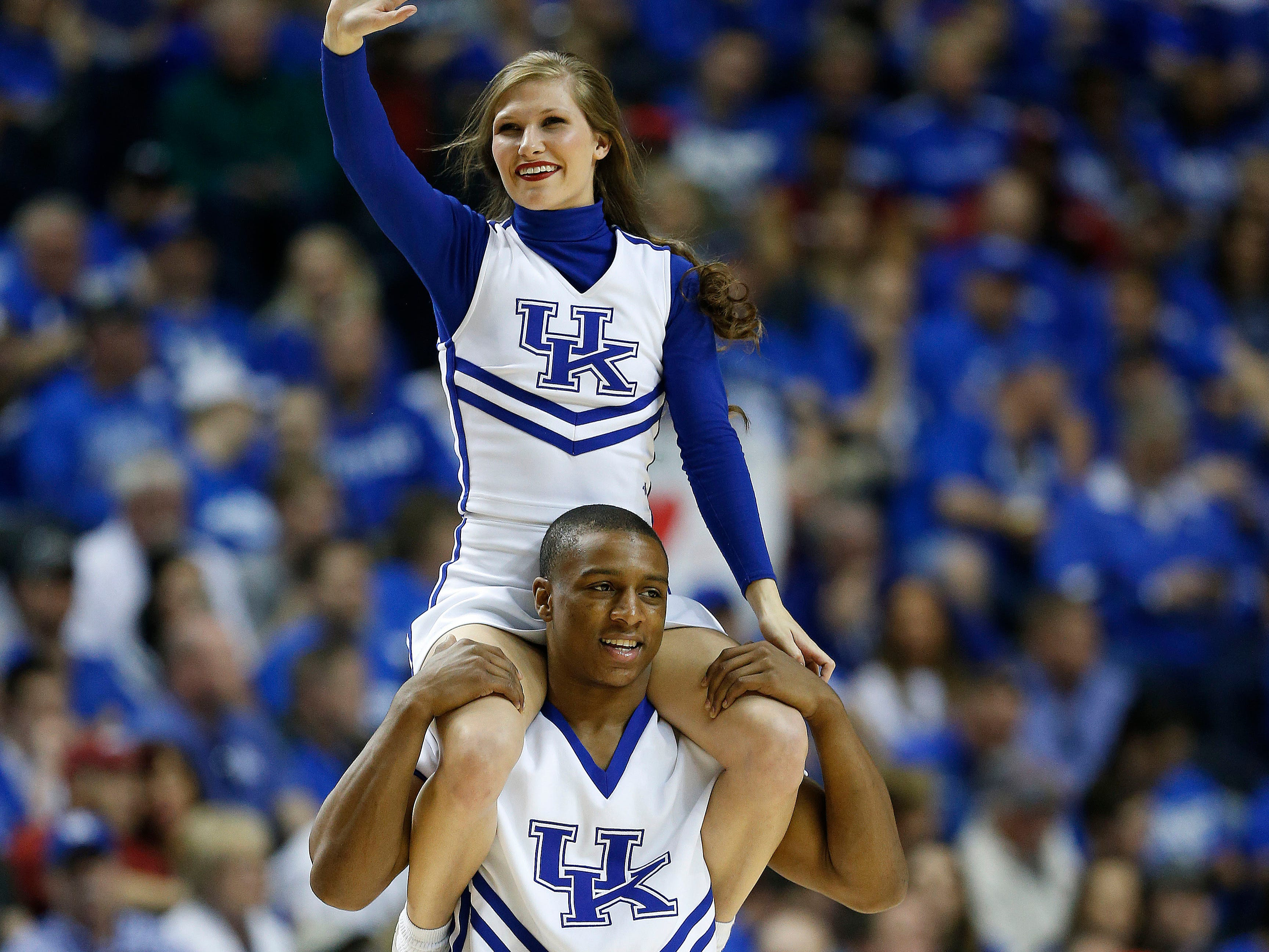 Kentucky cheerleaders perform during the first half of the NCAA college basketball Southeastern Conference tournament championship game between Kentucky and Arkansas, Sunday, March 15, 2015, in Nashville, Tenn. (AP Photo/Mark Humphrey)