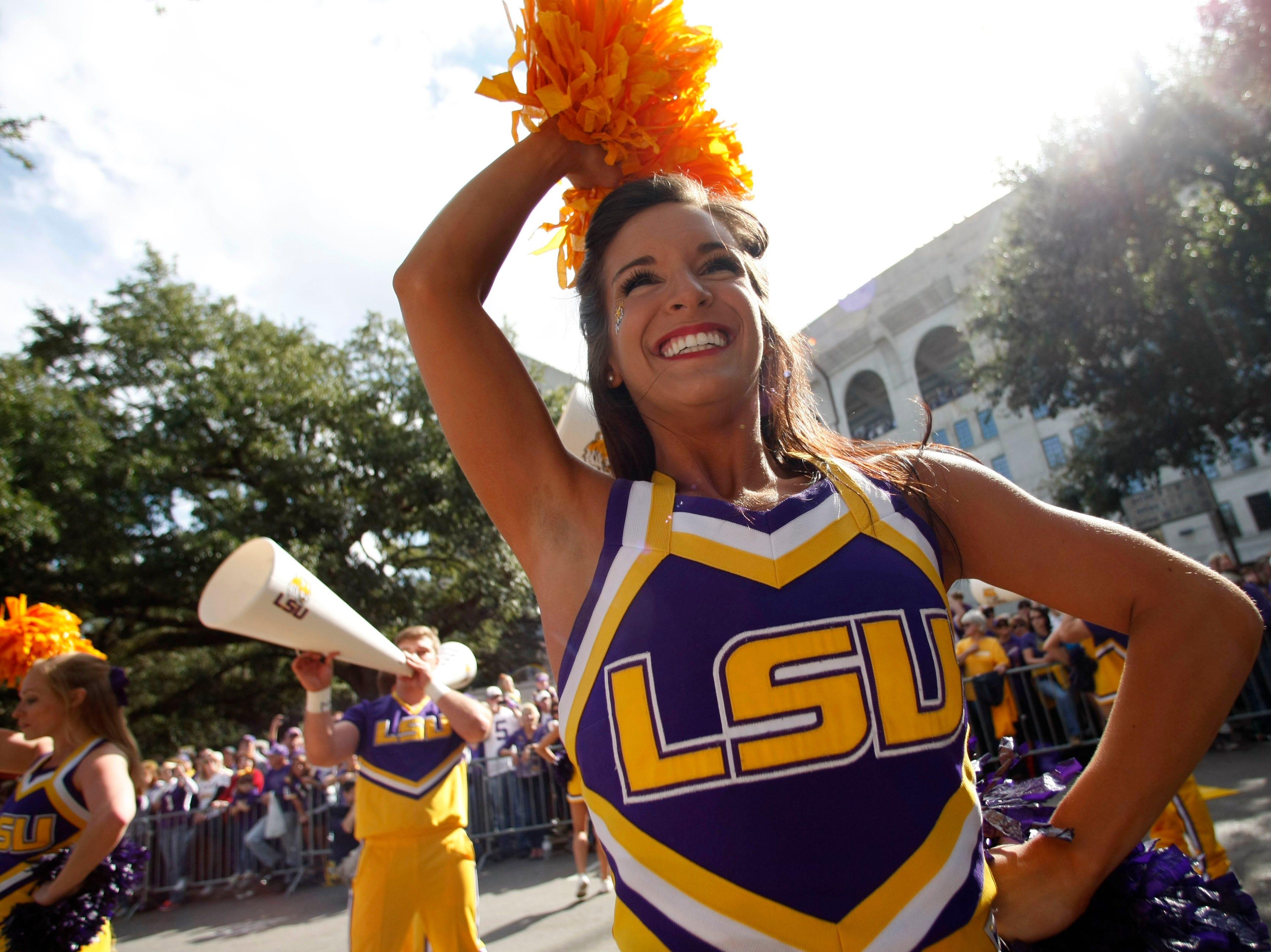 LSU cheerleaders pep up the crowd outside Tiger Stadium before their NCAA college football game against Arkansas in Baton Rouge, La., Friday, Nov. 25, 2011. (AP Photo/Gerald Herbert)