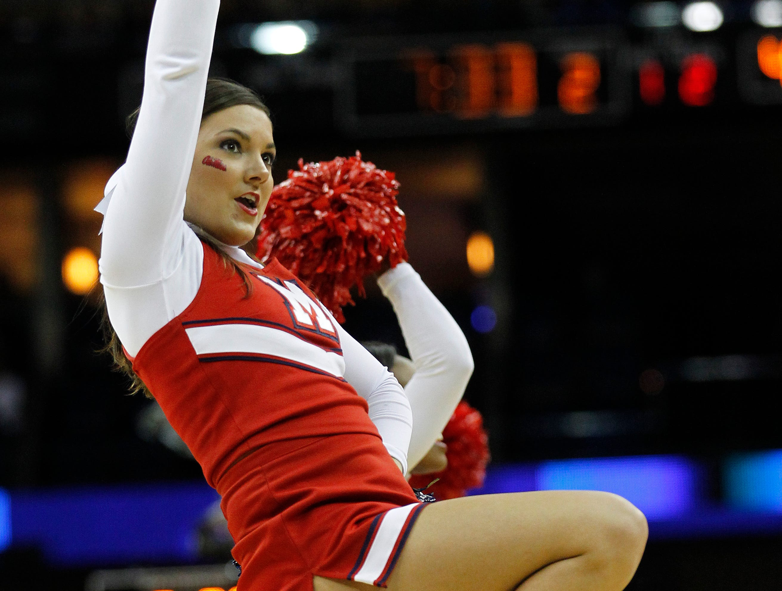 A Mississippi cheerleader performs during the second half of an NCAA college basketball game against Auburn in the first round of the 2012 Southeastern Conference tournament at the New Orleans Arena in New Orleans, Thursday, March 8, 2012. (AP Photo/Gerald Herbert)