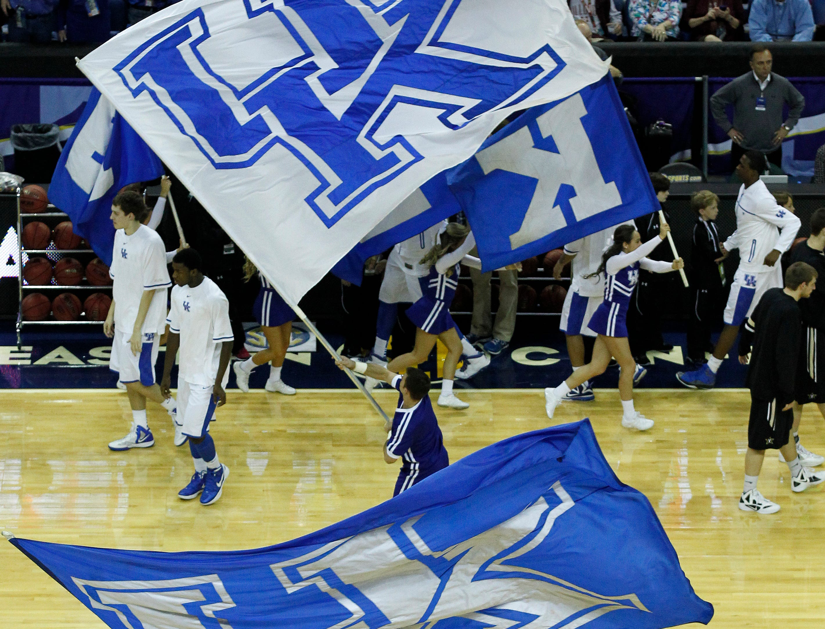 Kentucky cheerleaders perform during the first half of an NCAA college basketball game in the championship game of the 2012 Southeastern Conference tournament at the New Orleans Arena in New Orleans, Sunday, March 11, 2012. (AP Photo/Dave Martin)