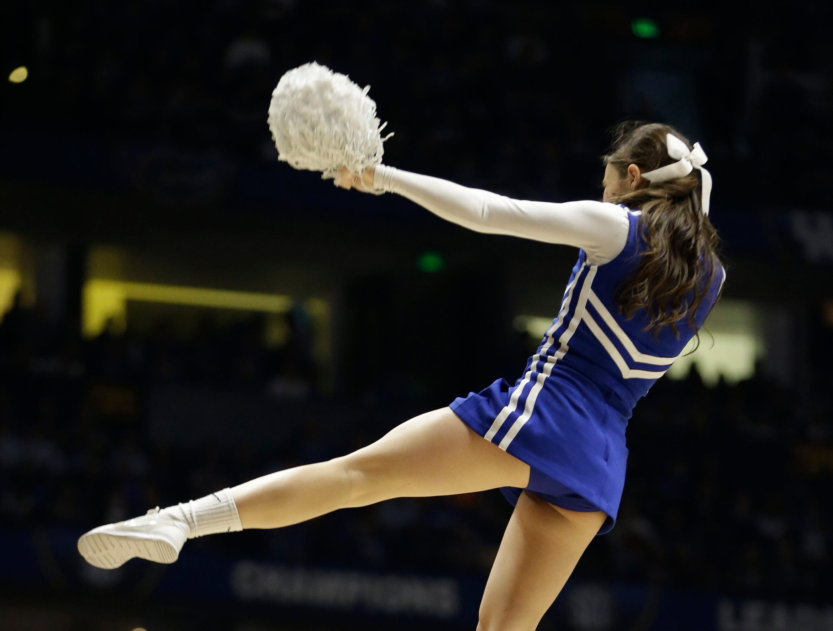 Kentucky cheerleaders perform during the first half of an NCAA college basketball game against Texas A&M in the championship of the Southeastern Conference tournament in Nashville, Tenn., Sunday, March 13, 2016. (AP Photo/Mark Humphrey)