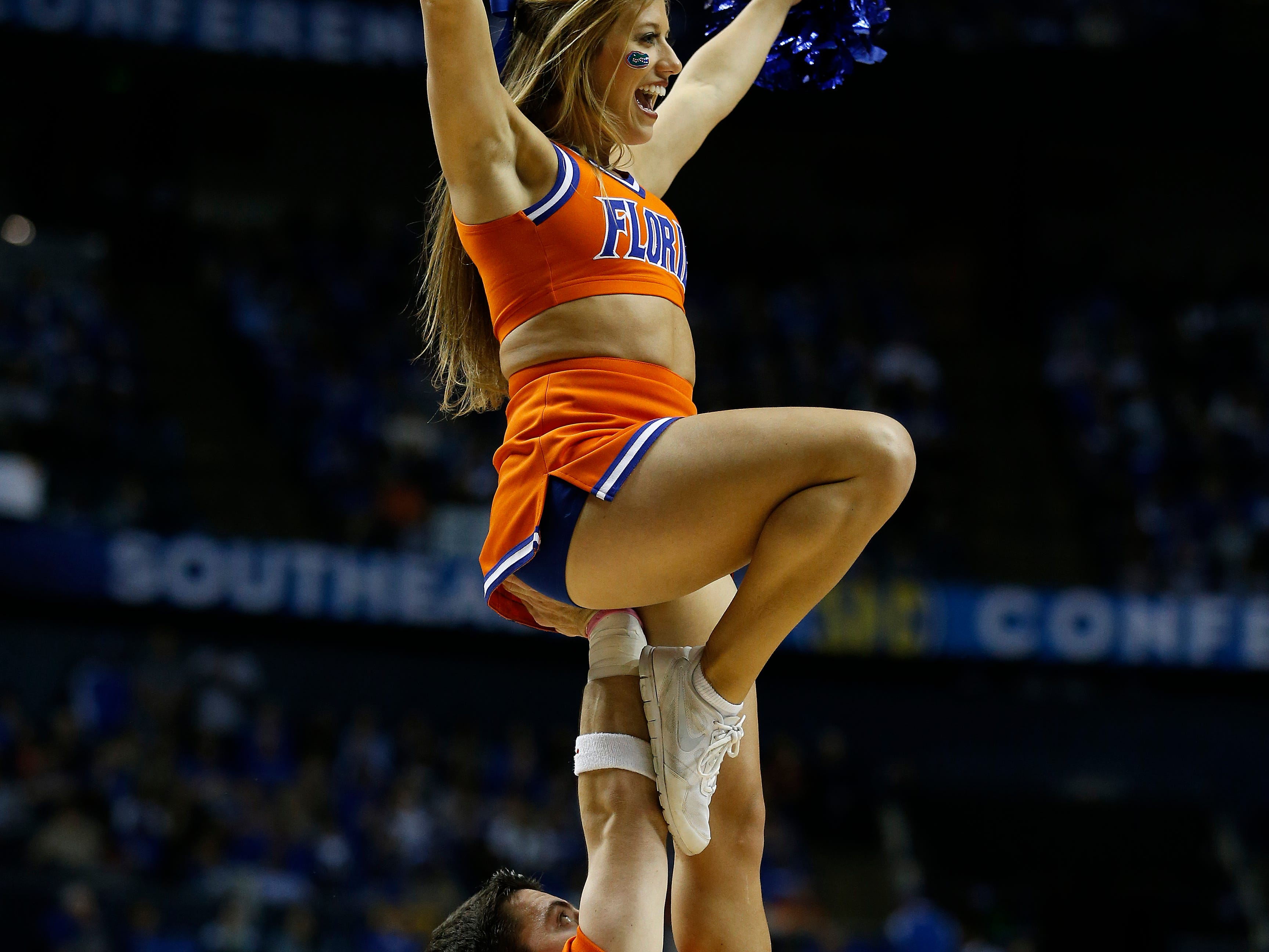 Florida cheerleaders perform during the first half of an NCAA college basketball game in the quarter final round of the Southeastern Conference tournament between Kentucky and Florida, Friday, March 13, 2015, in Nashville, Tenn. (AP Photo/Steve Helber)