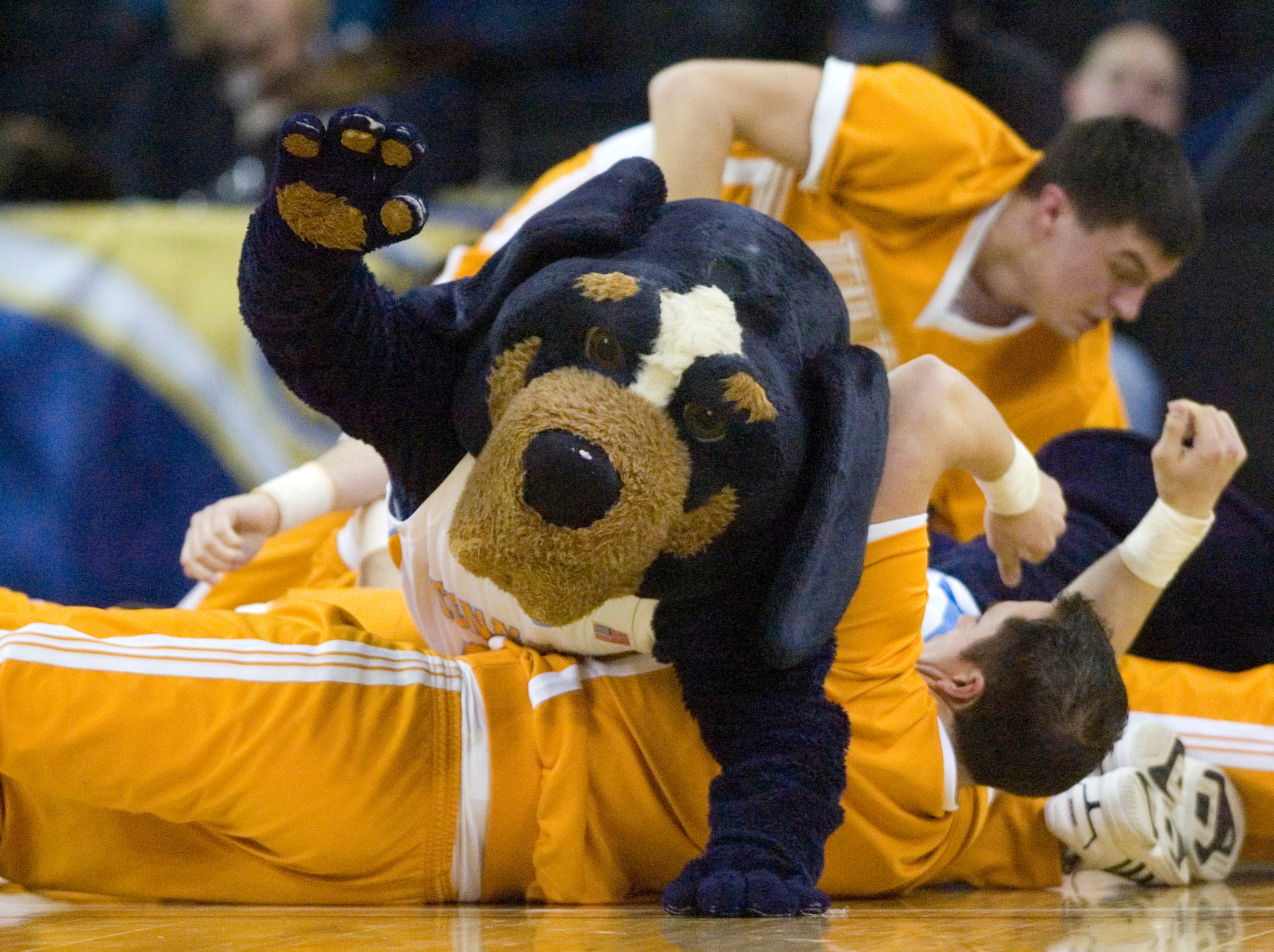 Tennessee mascot Smoky rolls over the Tennessee cheerleaders during a timeout against Vanderbilt in the second half during a semifinal game of the Southeastern Conference women's basketball tournament on Saturday, March 6, 2010, at The Arena at Gwinnett in Duluth, Ga. Tennessee defeated Vanderbilt 68-49. (AP Photo/Erik S. Lesser)