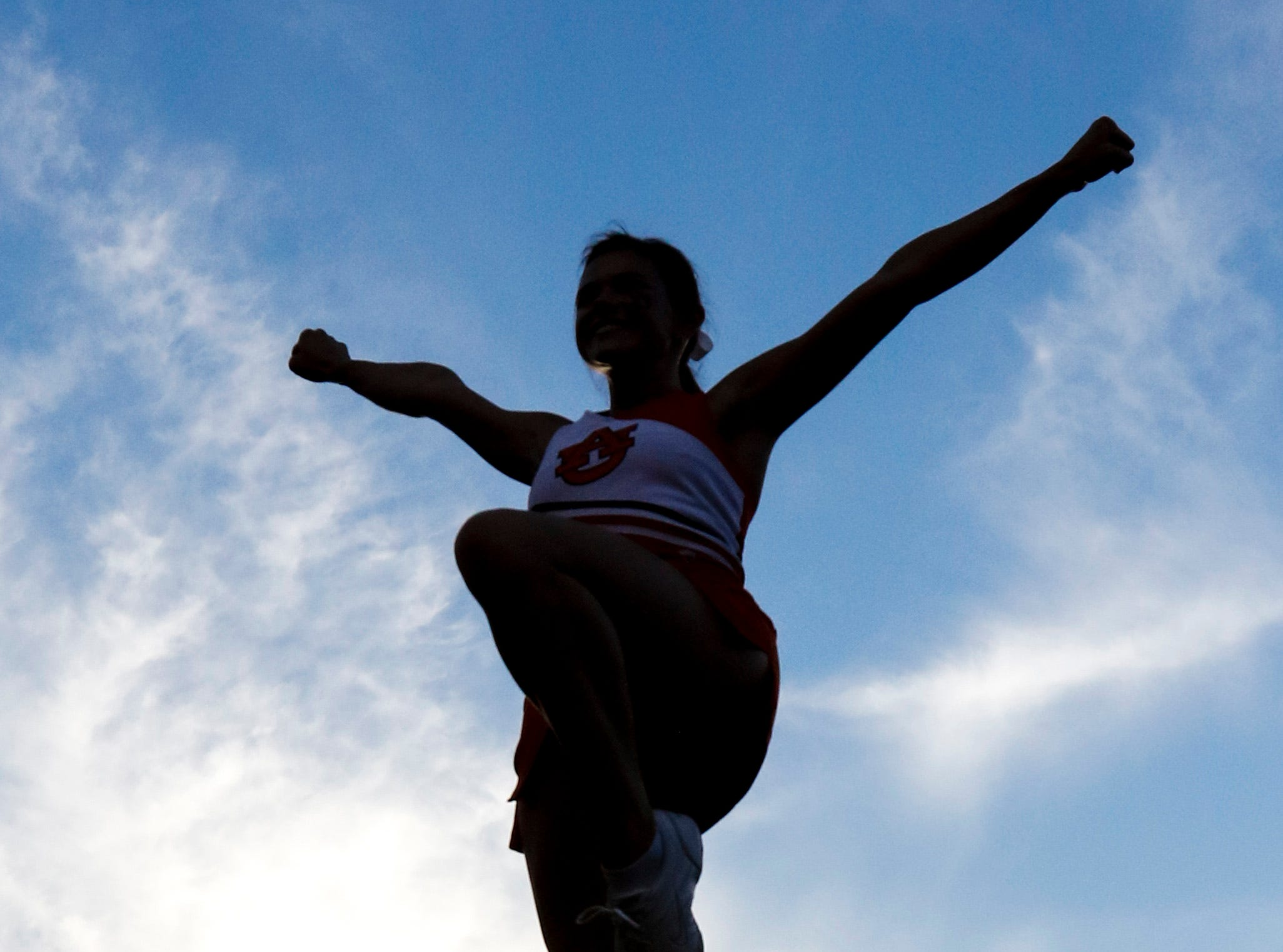 An Auburn  cheerleader performs before an NCAA college football game against Arkansas State, Saturday, Sept. 10, 2016, in Auburn, Ala. (AP Photo/Butch Dill)