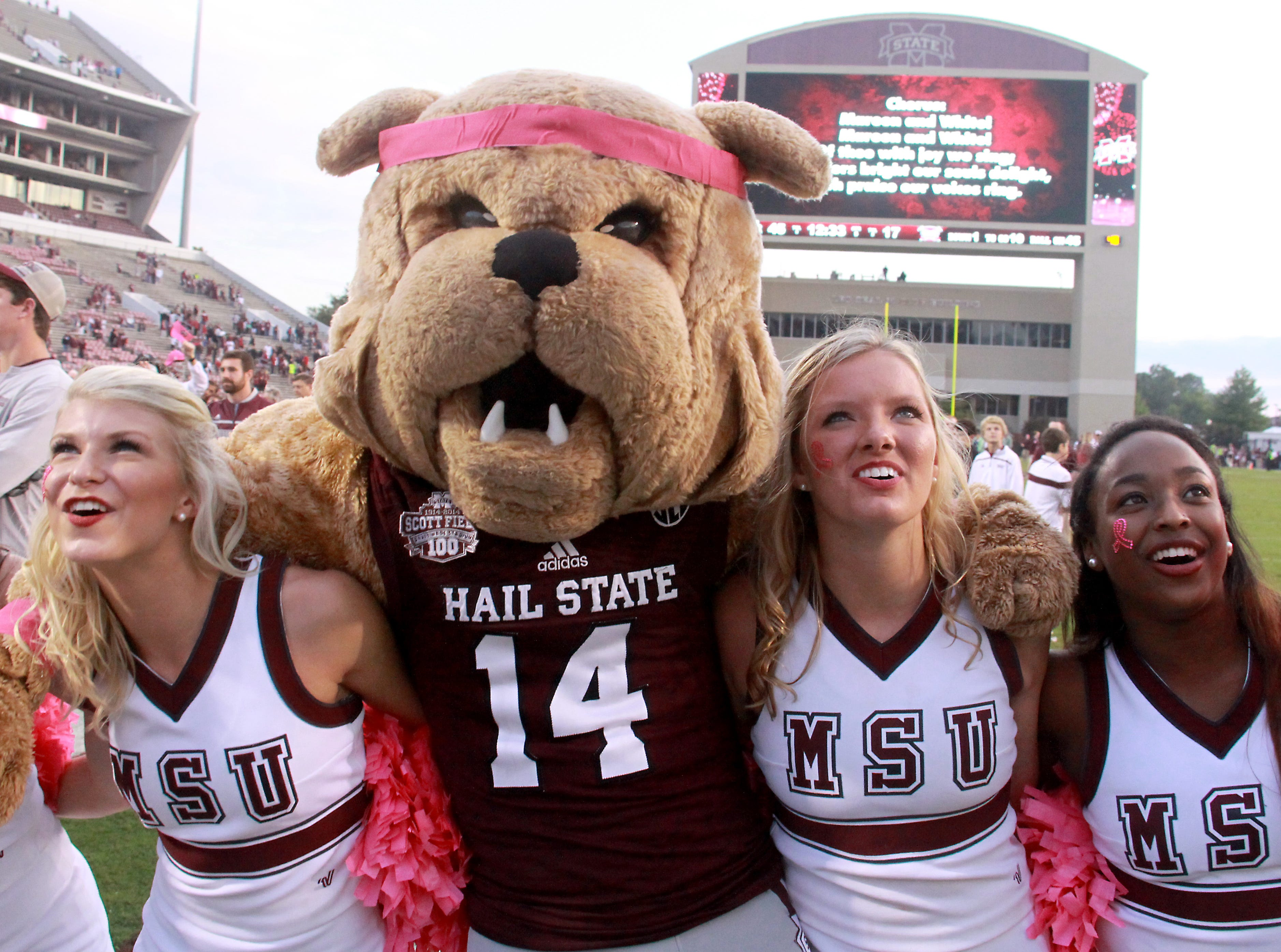 "Mississippi State cheerleaders and the school mascot ""Bully"" sing the Alma Mater following their 45-17 win over Troy in a NCAA college football game in Starkville, Miss., Saturday, Oct. 10, 2015.  (AP Photo/Jim Lytle)"