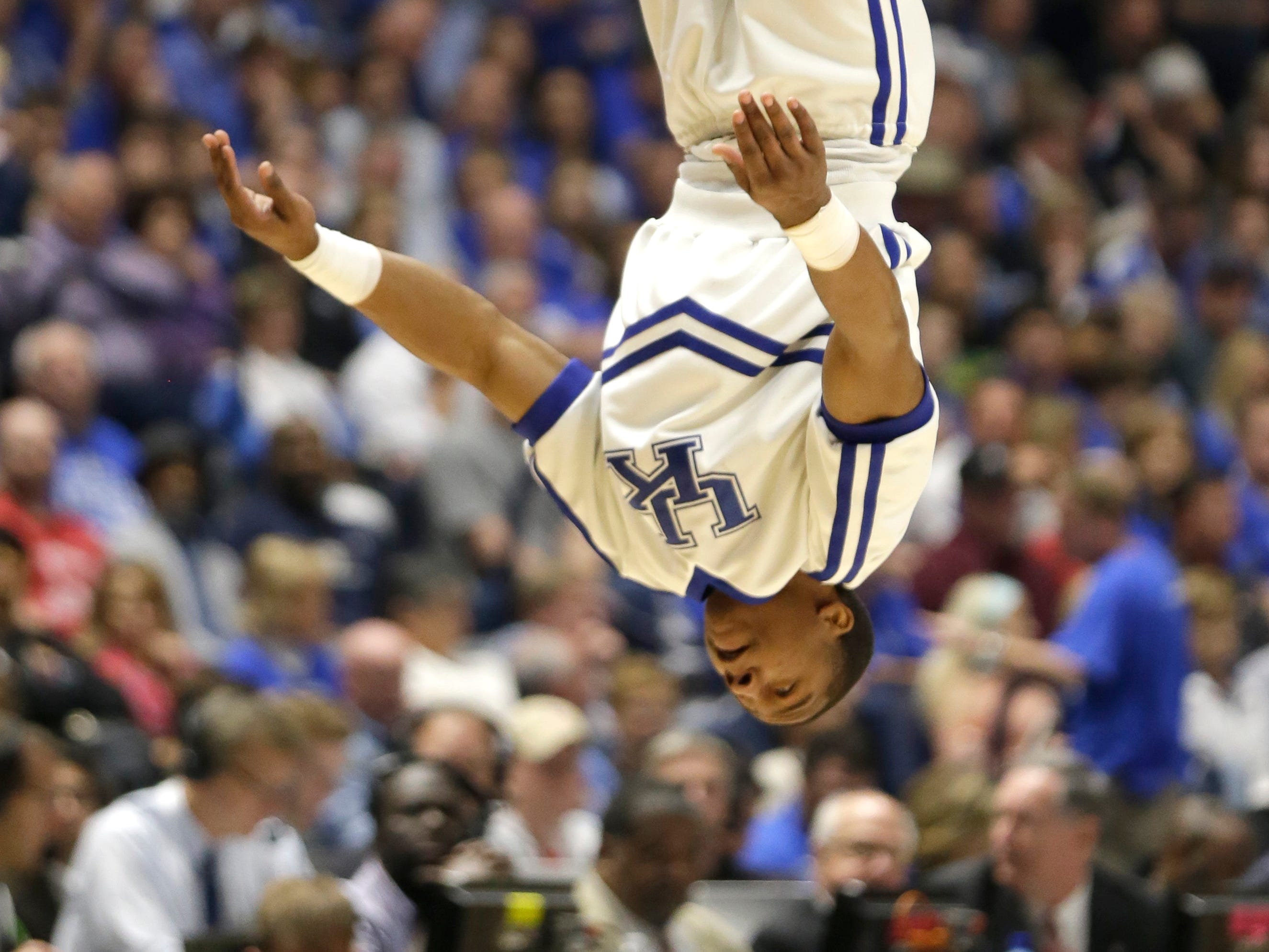 A Kentucky cheerleader performs during the first half of an NCAA college basketball game against Georgia in the Southeastern Conference tournament in Nashville, Tenn., Saturday, March 12, 2016. (AP Photo/Mark Humphrey)