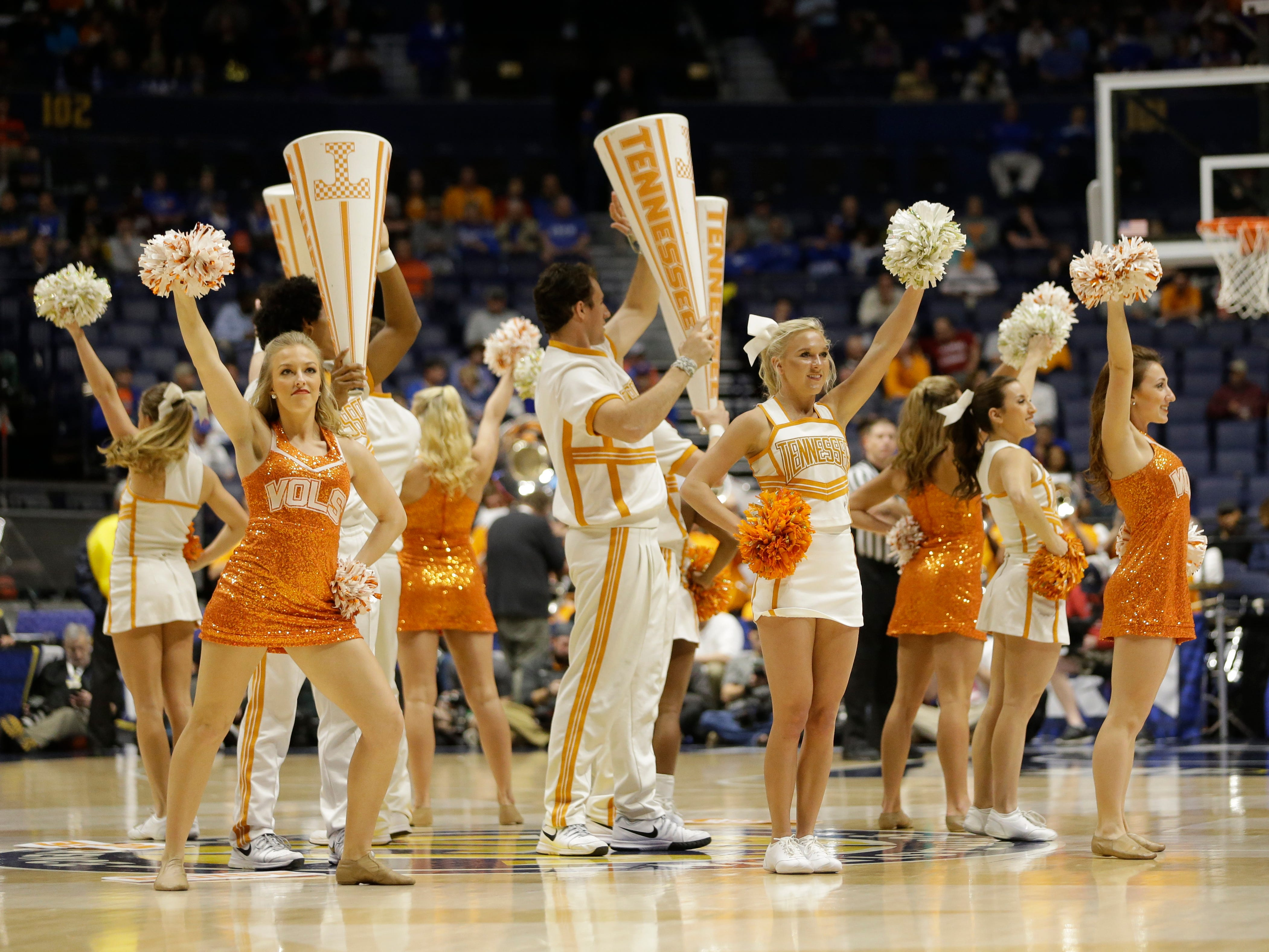 Tennessee cheerleaders perform during the second half of an NCAA college basketball game against Vanderbilt in the Southeastern Conference tournament in Nashville, Tenn., Thursday, March 10, 2016. (AP Photo/Mark Humphrey)