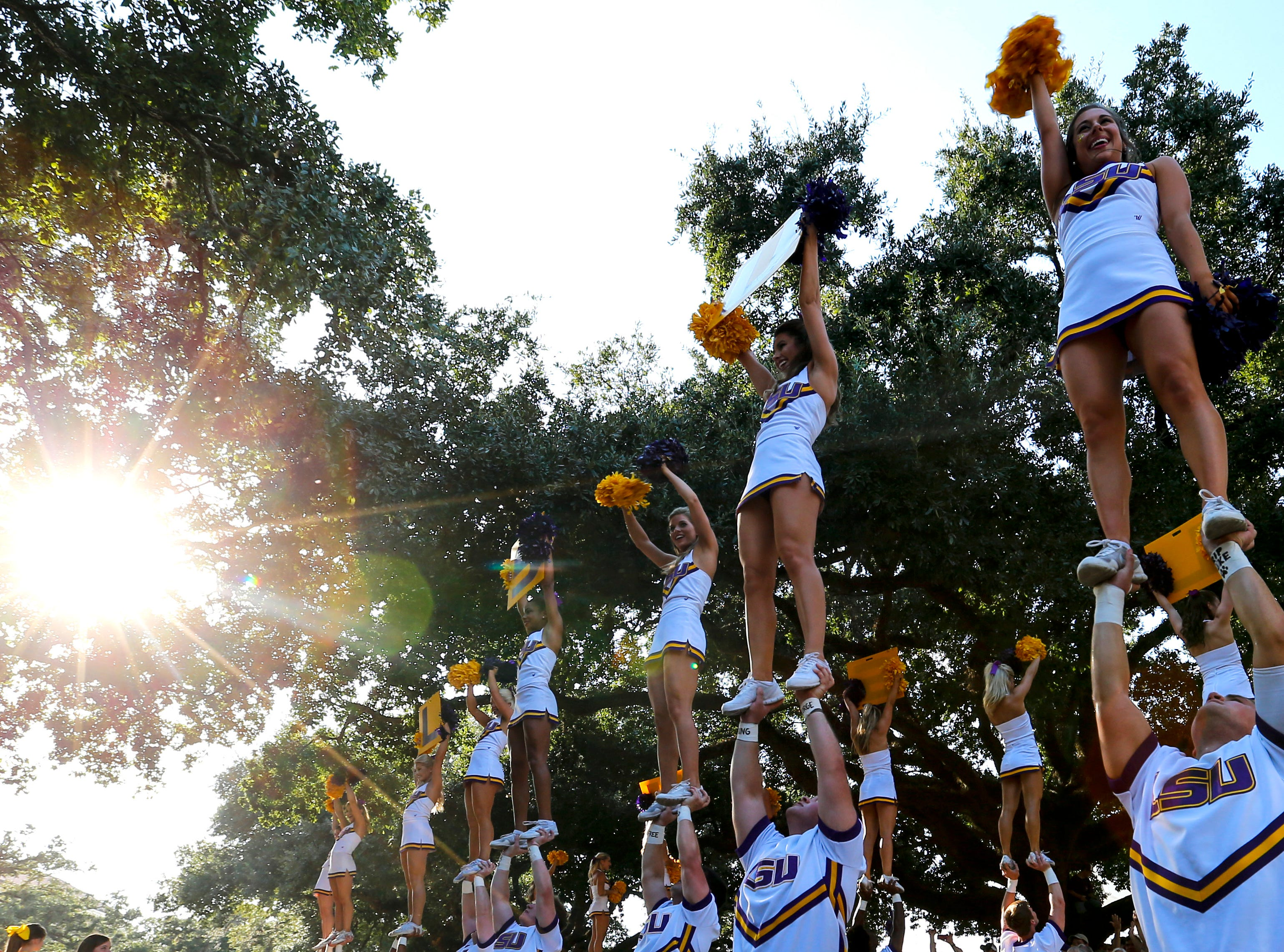 LSU  cheerleaders lead the fans in a cheer before an NCAA college football game, Saturday, Oct. 15, 2016, in Baton Rouge, La. (AP Photo/Butch Dill)