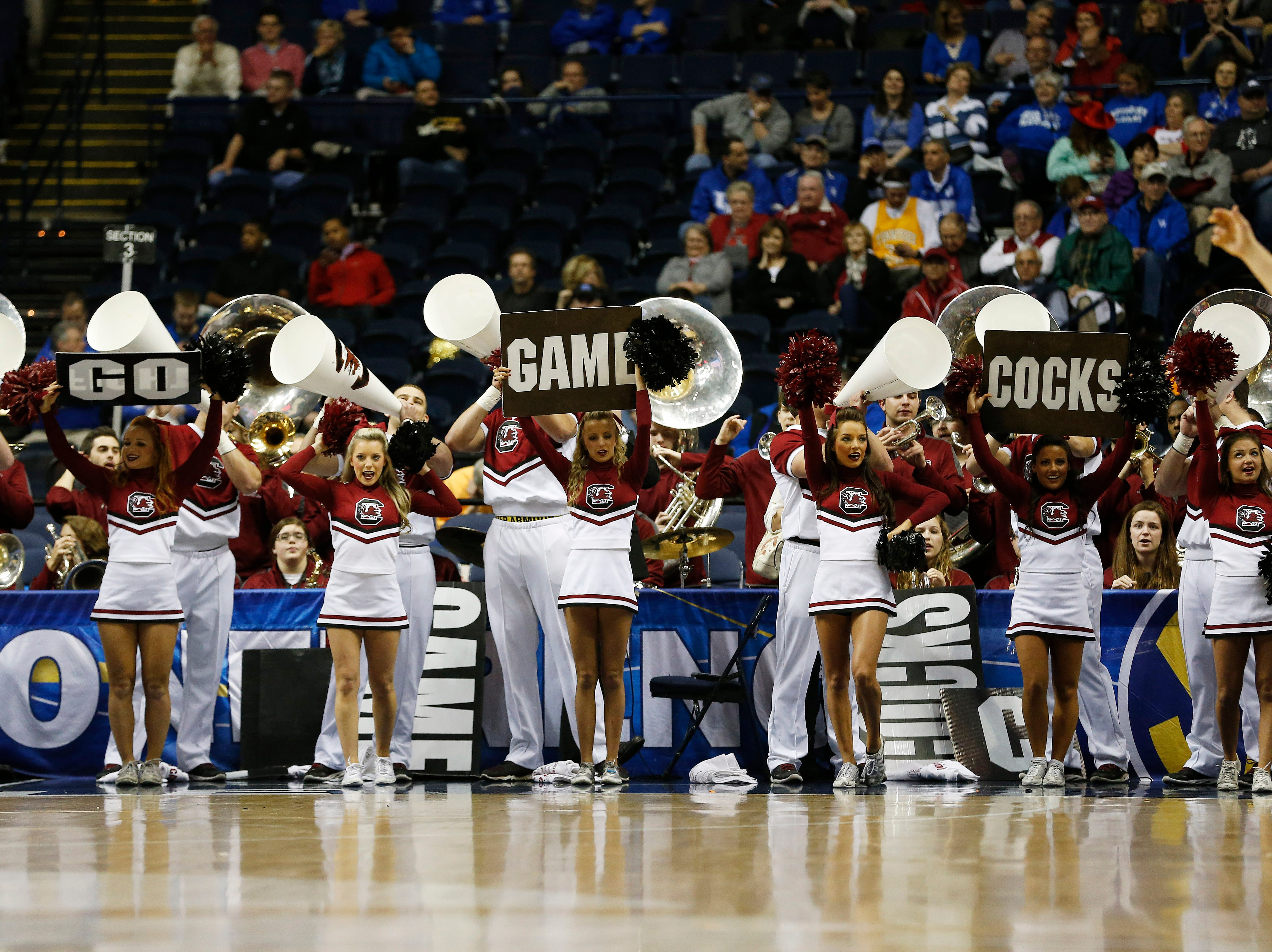 South Carolina cheerleaders perform during the first half of an NCAA college basketball game in the second round of the Southeastern Conference tournament against Mississippi, Thursday, March 12, 2015, in Nashville, Tenn. (AP Photo/Steve Helber)