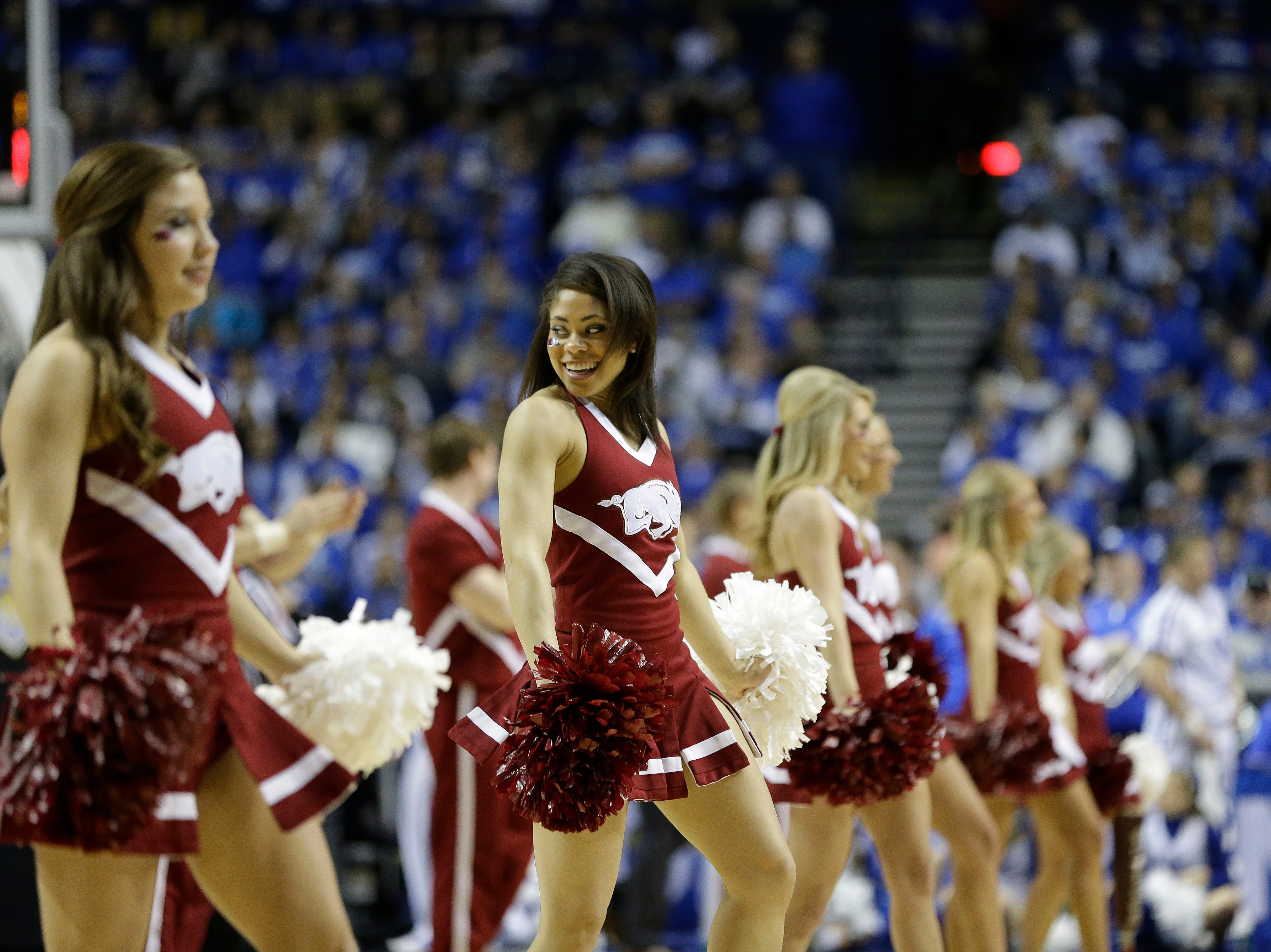 Arkansas cheerleaders perform during the first half of the NCAA college basketball Southeastern Conference tournament championship game between Kentucky and Arkansas, Sunday, March 15, 2015, in Nashville, Tenn. (AP Photo/Mark Humphrey)