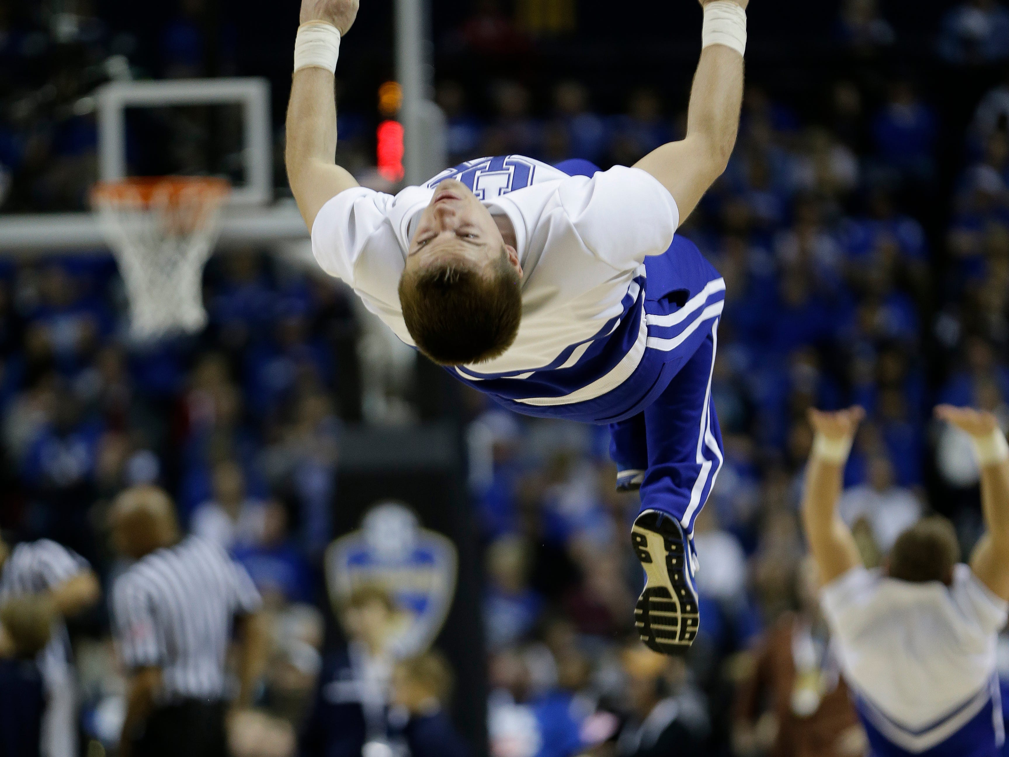 Kentucky cheerleaders perform during the second half of an NCAA college basketball game in the semifinal round of the Southeastern Conference tournament against Auburn, Saturday, March 14, 2015, in Nashville, Tenn. (AP Photo/Mark Humphrey)