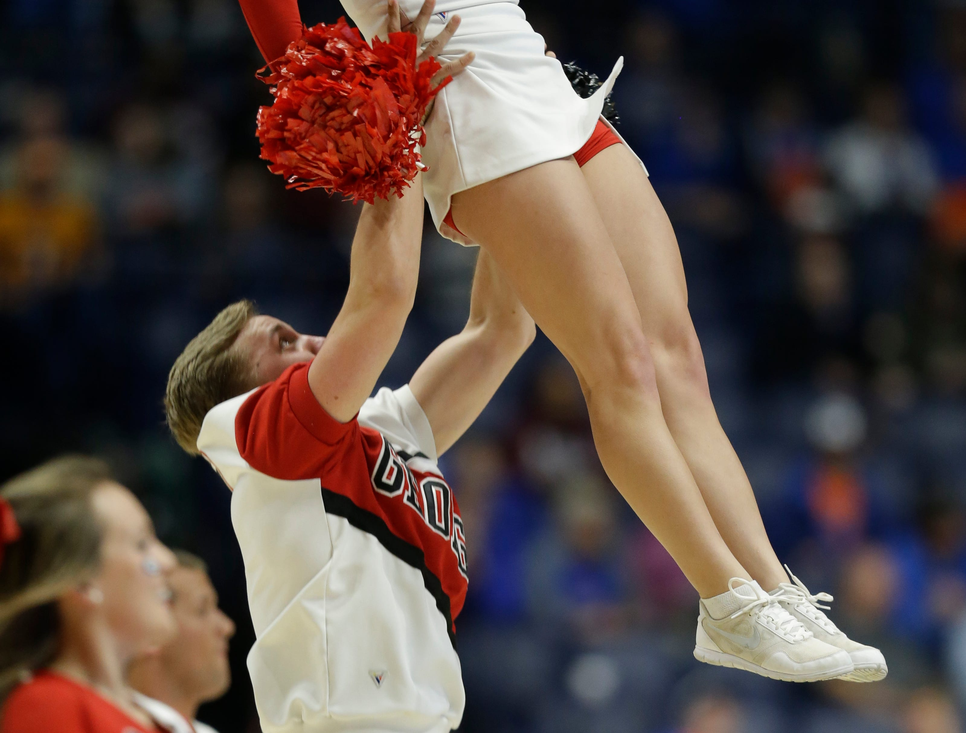 A Georgia cheerleader performs during the first half of an NCAA college basketball game against Mississippi State in the Southeastern Conference tournament in Nashville, Tenn., Thursday, March 10, 2016. (AP Photo/Mark Humphrey)