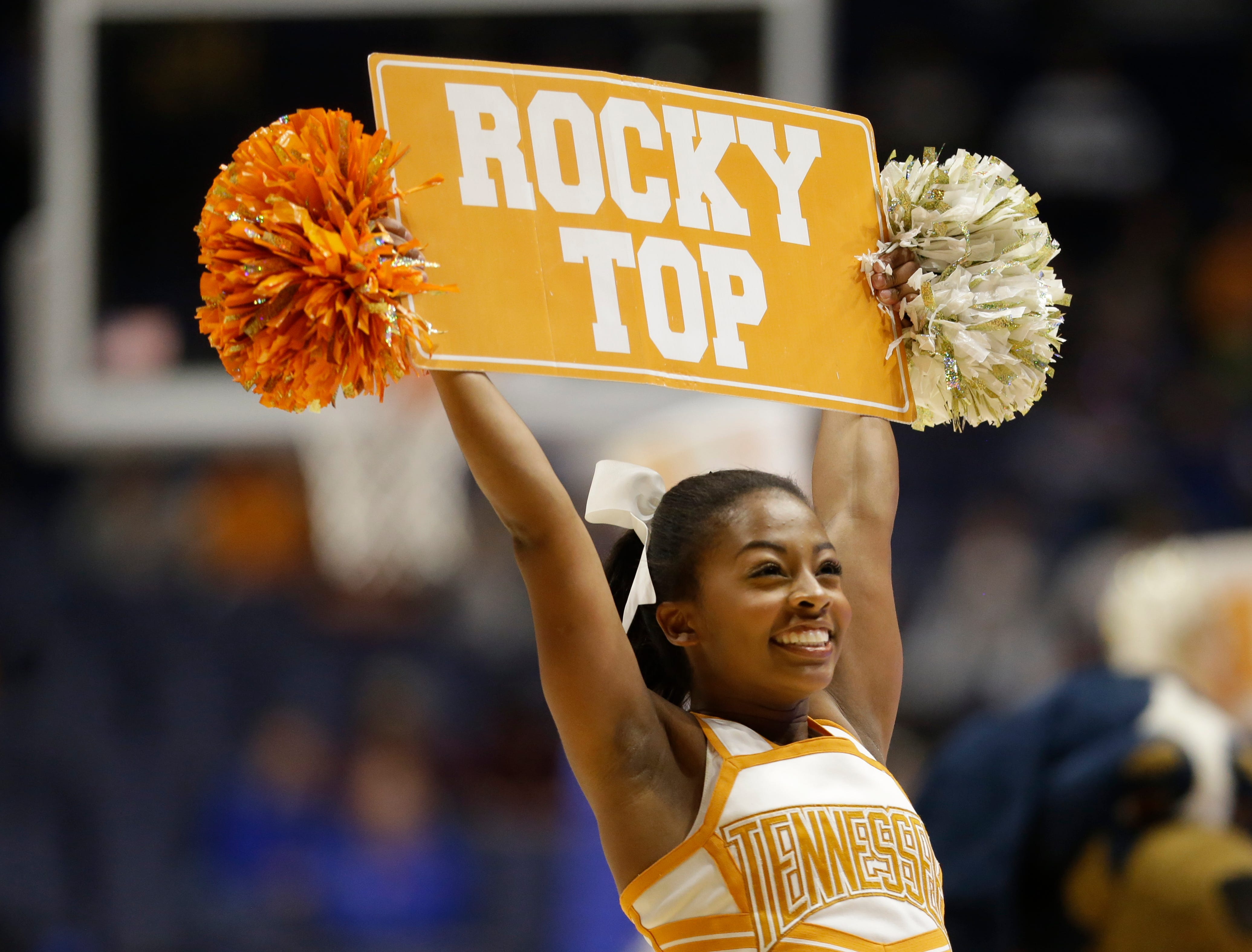 A Tennessee cheerleader performs during the first half of an NCAA college basketball game against Vanderbilt in the Southeastern Conference tournament in Nashville, Tenn., Thursday, March 10, 2016. (AP Photo/Mark Humphrey)