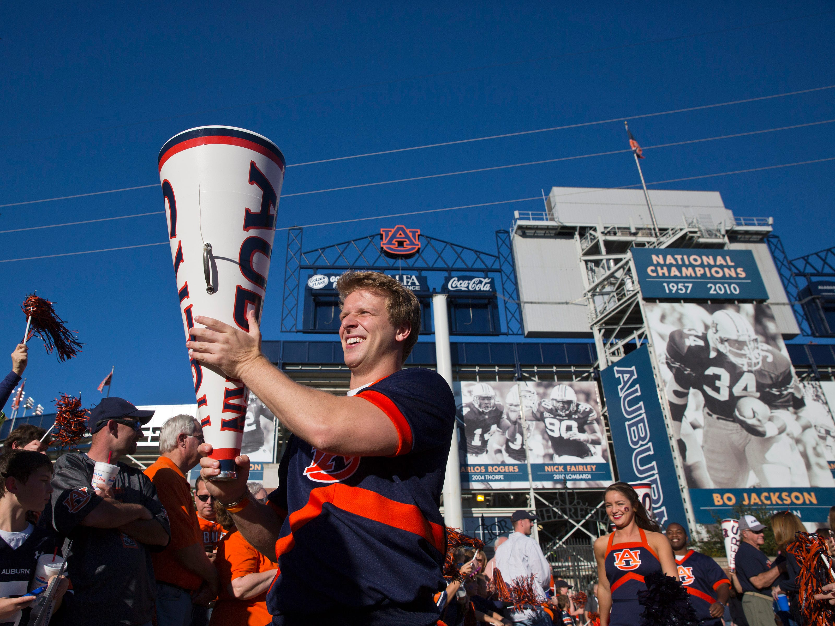 An Auburn cheerleader walks out during the Tiger Walk before an NCAA college football game against South Carolina on Saturday, Oct. 25, 2014, in Auburn, Ala. (AP Photo/Brynn Anderson)