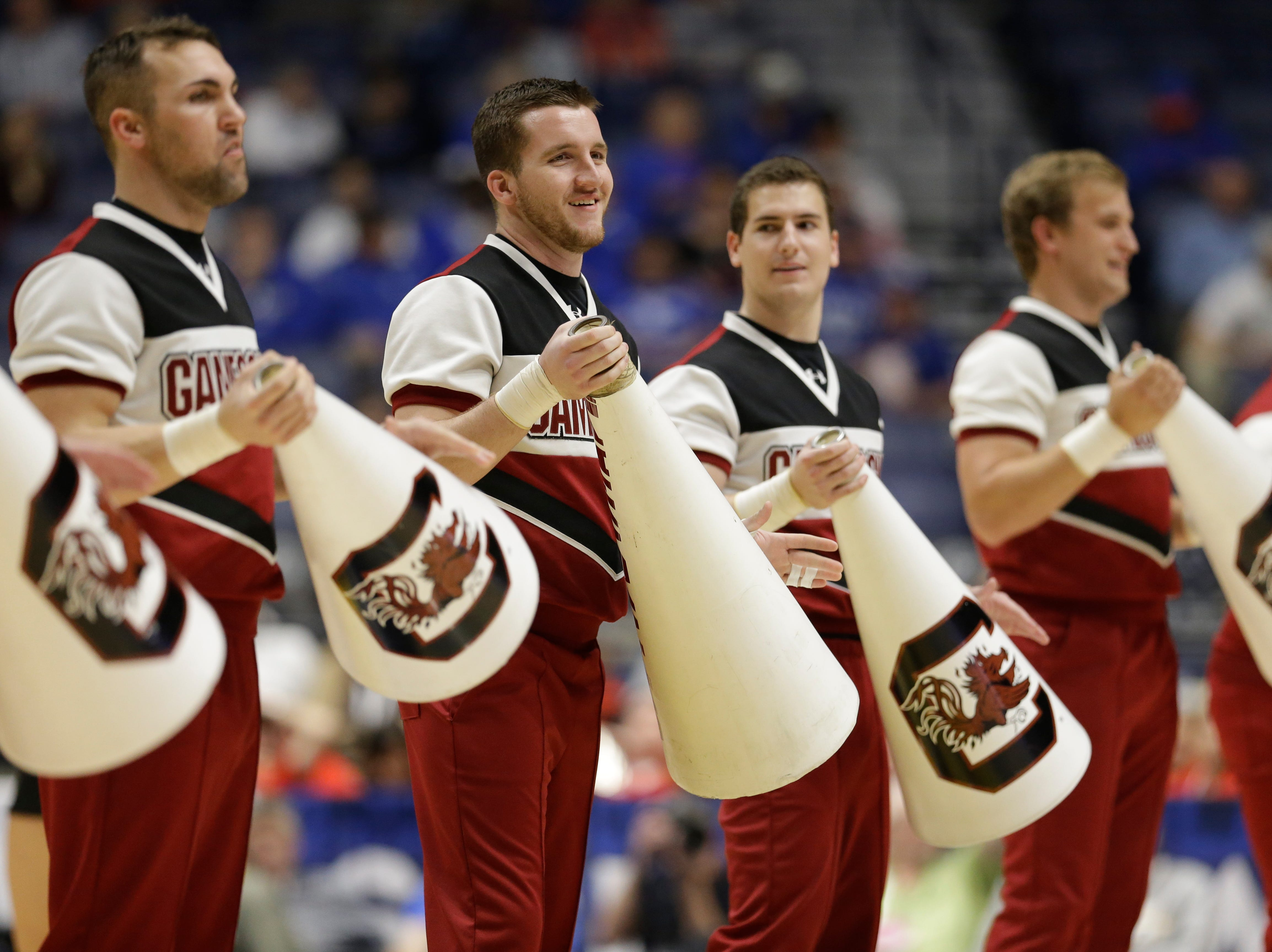 South Carolina cheerleaders perform during the first half of an NCAA college basketball game against Georgia in the Southeastern Conference tournament in Nashville, Tenn., Friday, March 11, 2016. (AP Photo/Mark Humphrey)