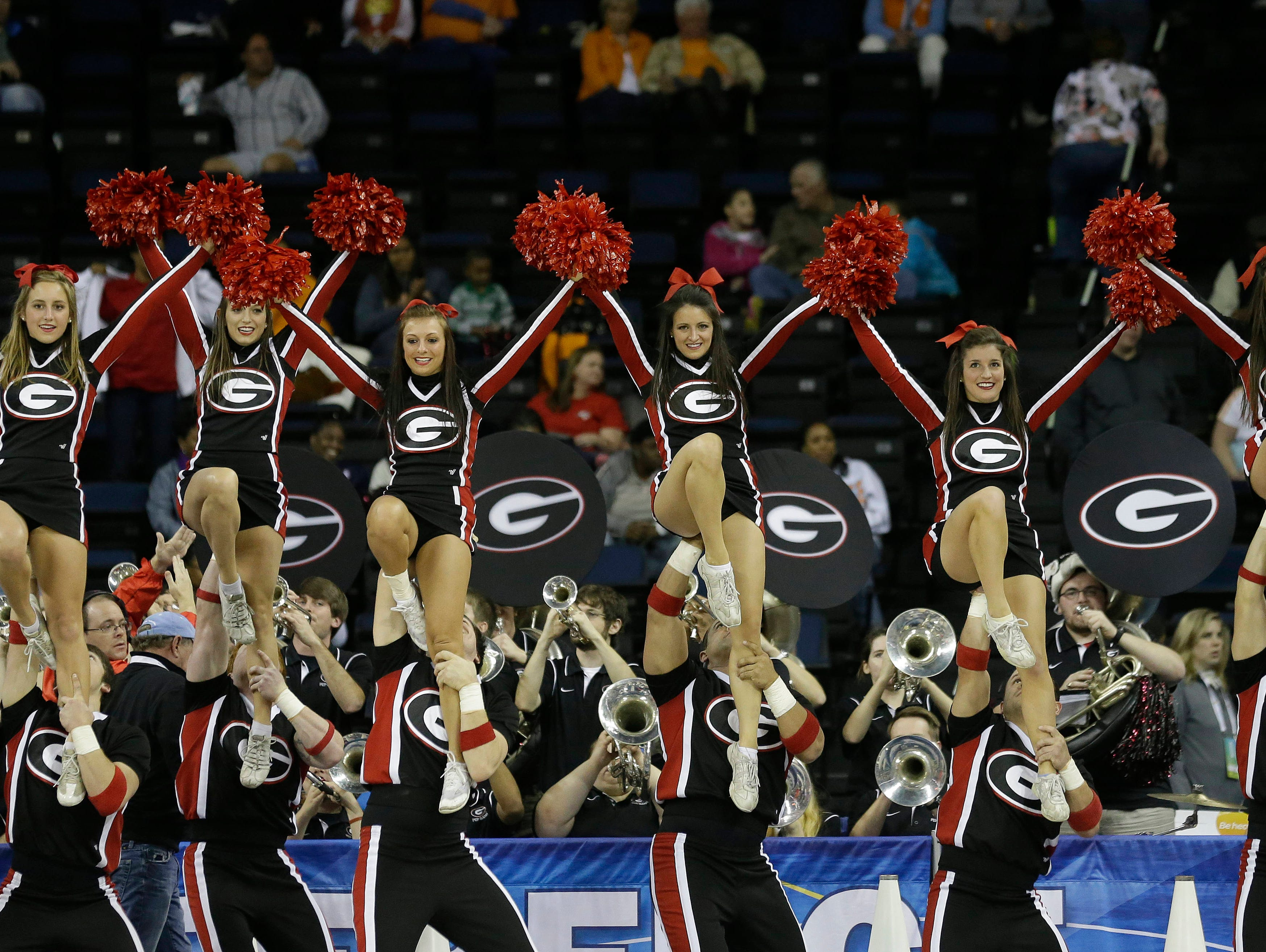 Georgia Bulldogs cheerleader perform during the first half of their NCAA college basketball game against Kentucky in the Southeastern Conference tournament, Saturday, March 9, 2013, in Duluth, Ga. Texas A&M  won 66-62. (AP Photo/John Bazemore)