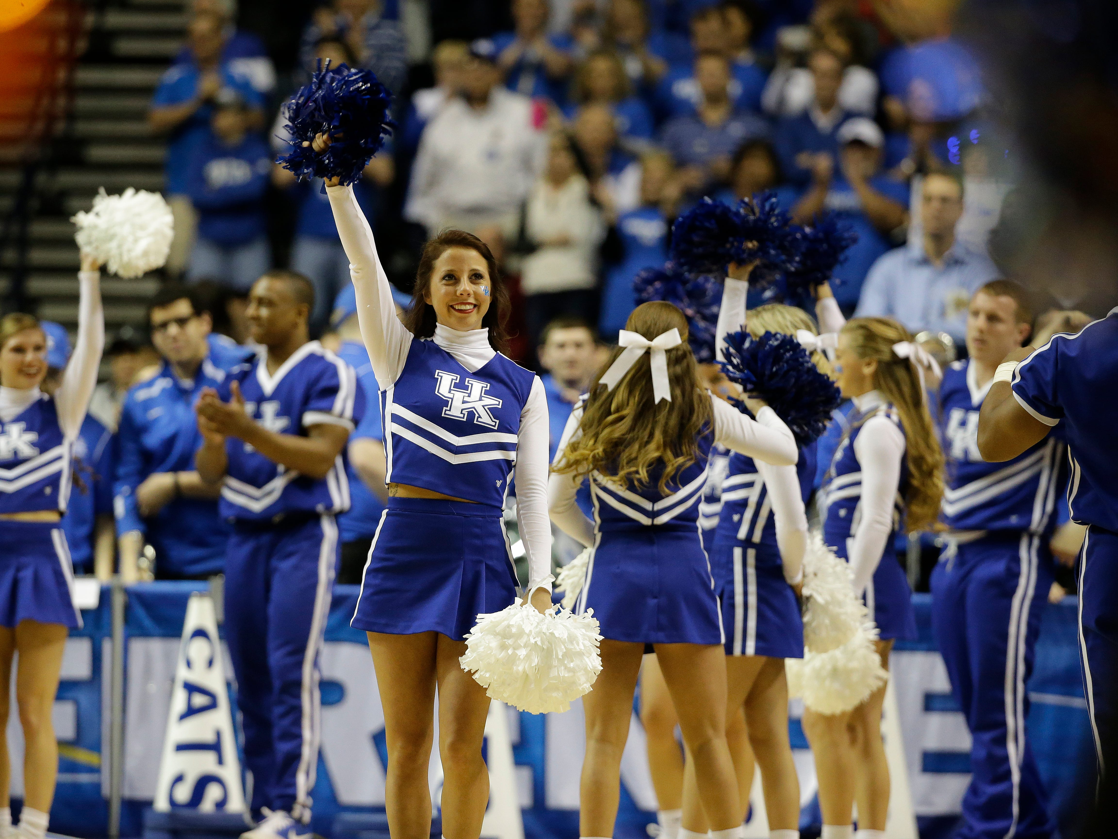 Kentucky cheerleaders perform during the first half of an NCAA college basketball game in the quarter final round of the Southeastern Conference tournament between Kentucky and Florida, Friday, March 13, 2015, in Nashville, Tenn. (AP Photo/Mark Humphrey)