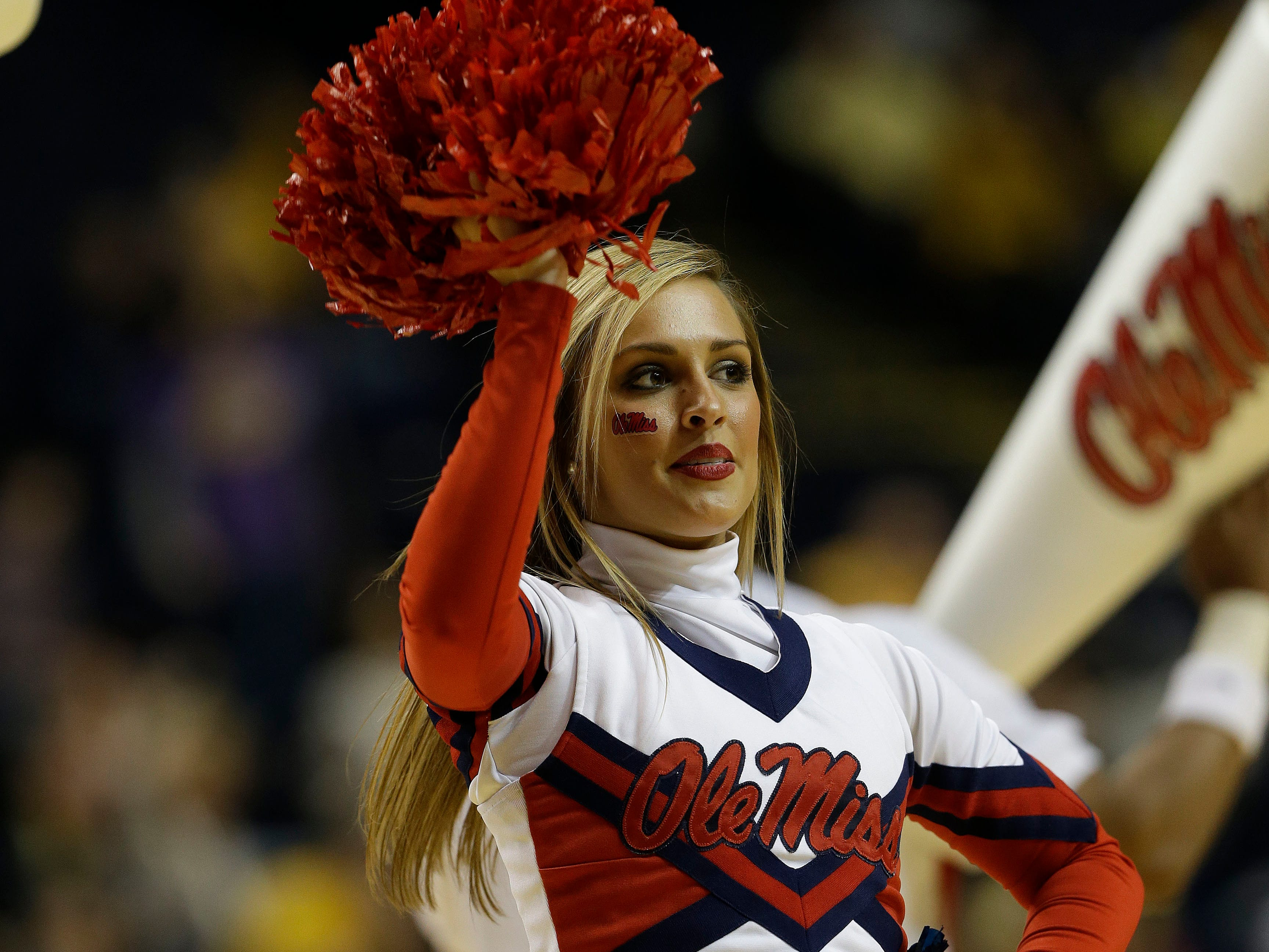 Mississippi cheerleaders perform during the second half of an NCAA college basketball game against Missouri at the Southeastern Conference tournament, Friday, March 15, 2013, in Nashville, Tenn. (AP Photo/Dave Martin)