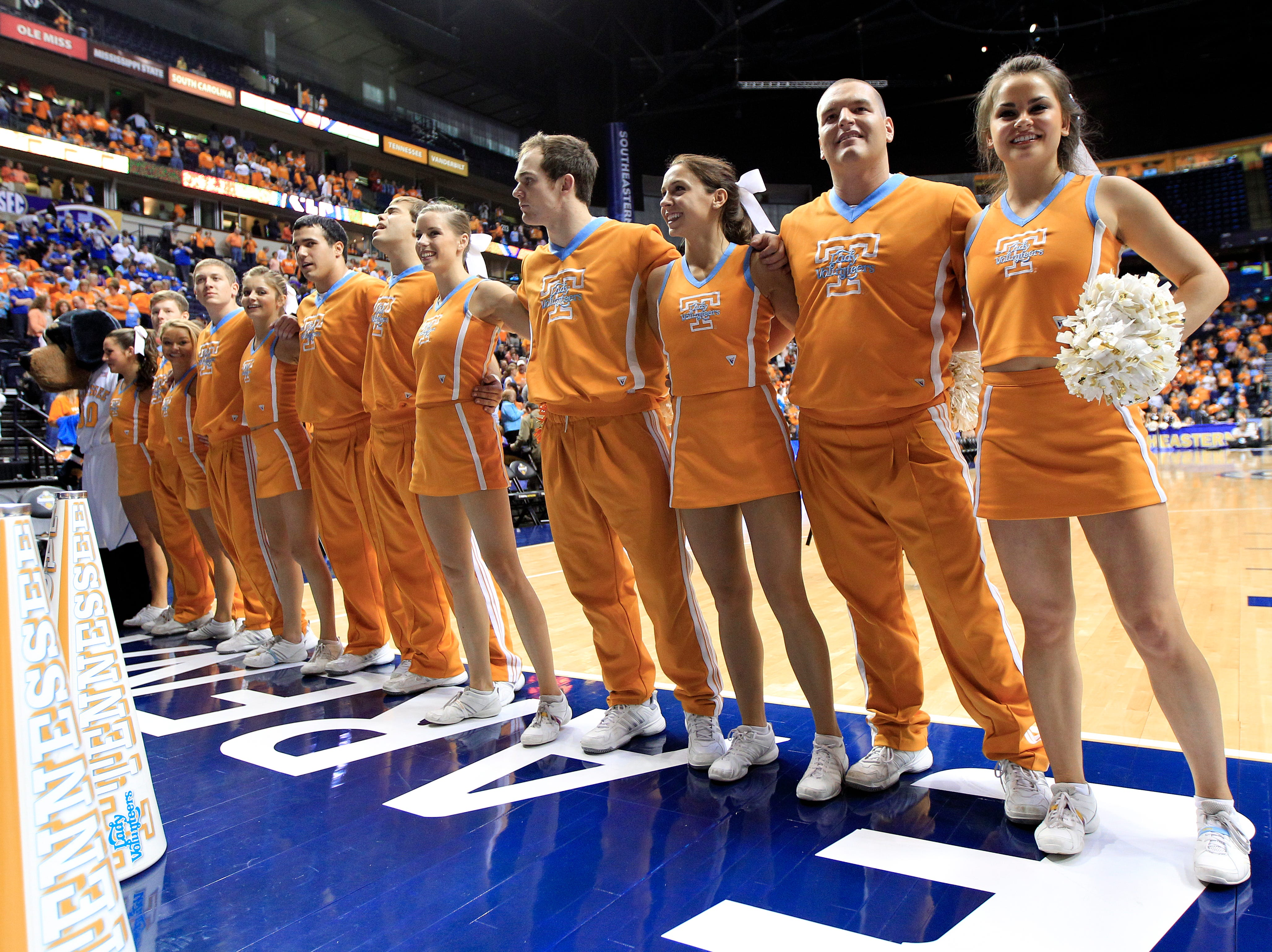 Tennessee cheerleaders sing the school song after Tennessee beat Vanderbilt in an NCAA college basketball game at the women's Southeastern Conference tournament on Friday, March 2, 2012, in Nashville, Tenn. Tennessee won 68-57. (AP Photo/Mark Humphrey)