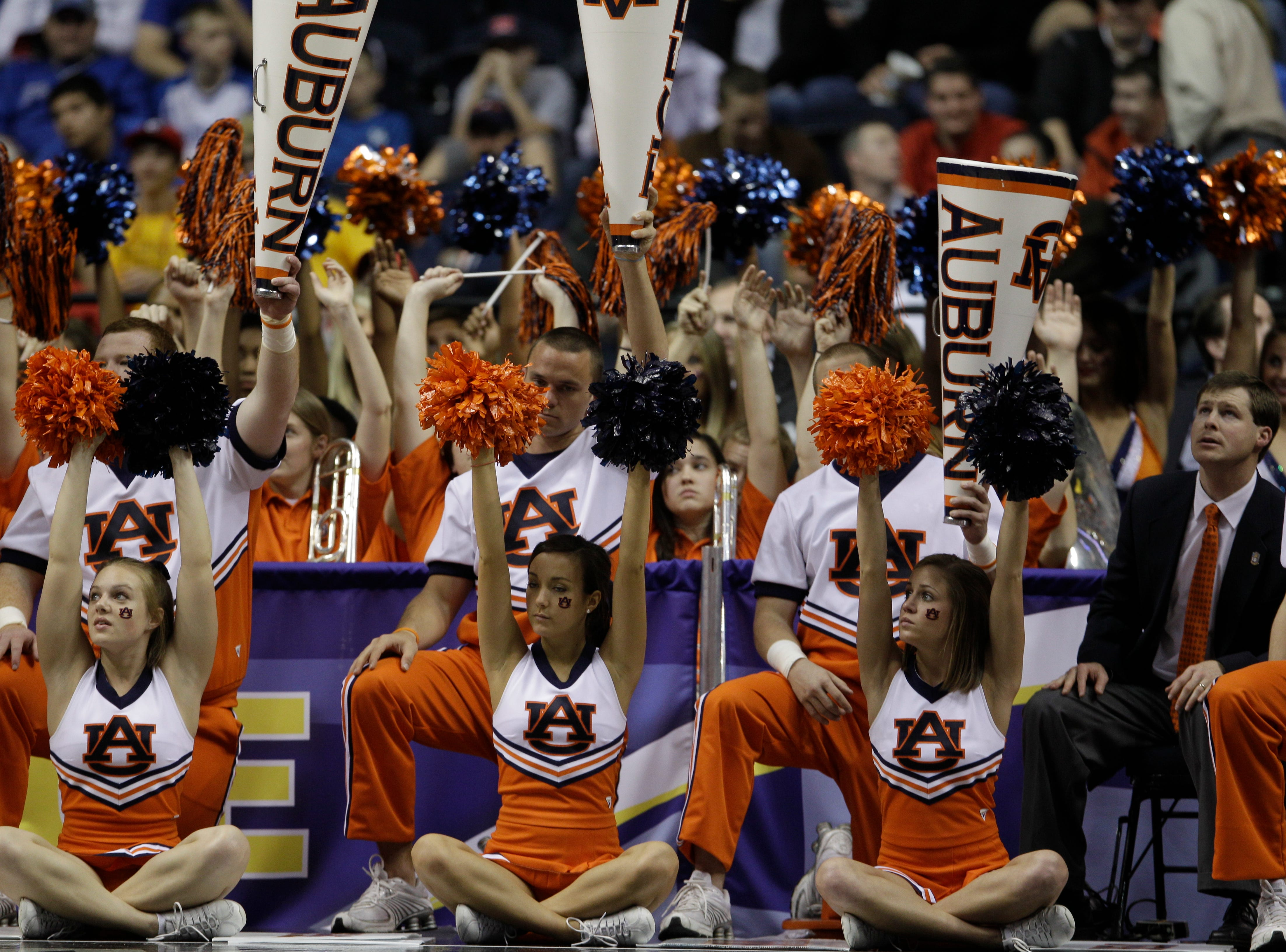 Auburn cheerleaders perform in the second half of an NCAA college basketball game against Florida on Thursday, March 11, 2010, at the Southeastern Conference tournament in Nashville, Tenn. Florida won 78-69. (AP Photo/Mark Humphrey)