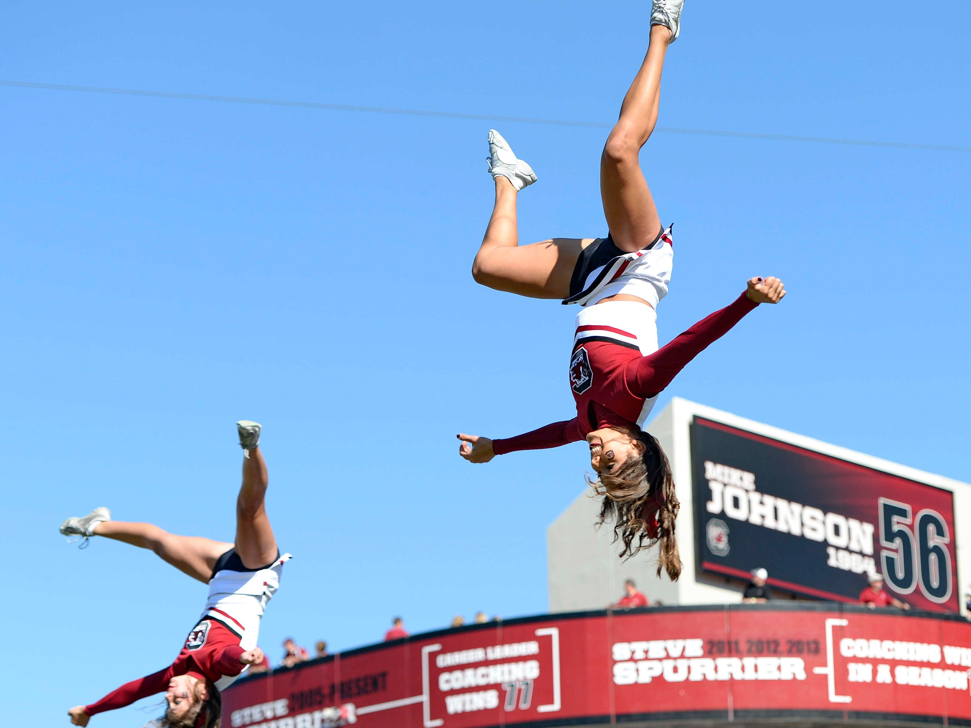 South Carolina cheerleaders perform stunts during an NCAA college football game against Furman in Columbia, S.C.,  Saturday, Oct. 18, 2014. (AP Photo/ Richard Shiro)