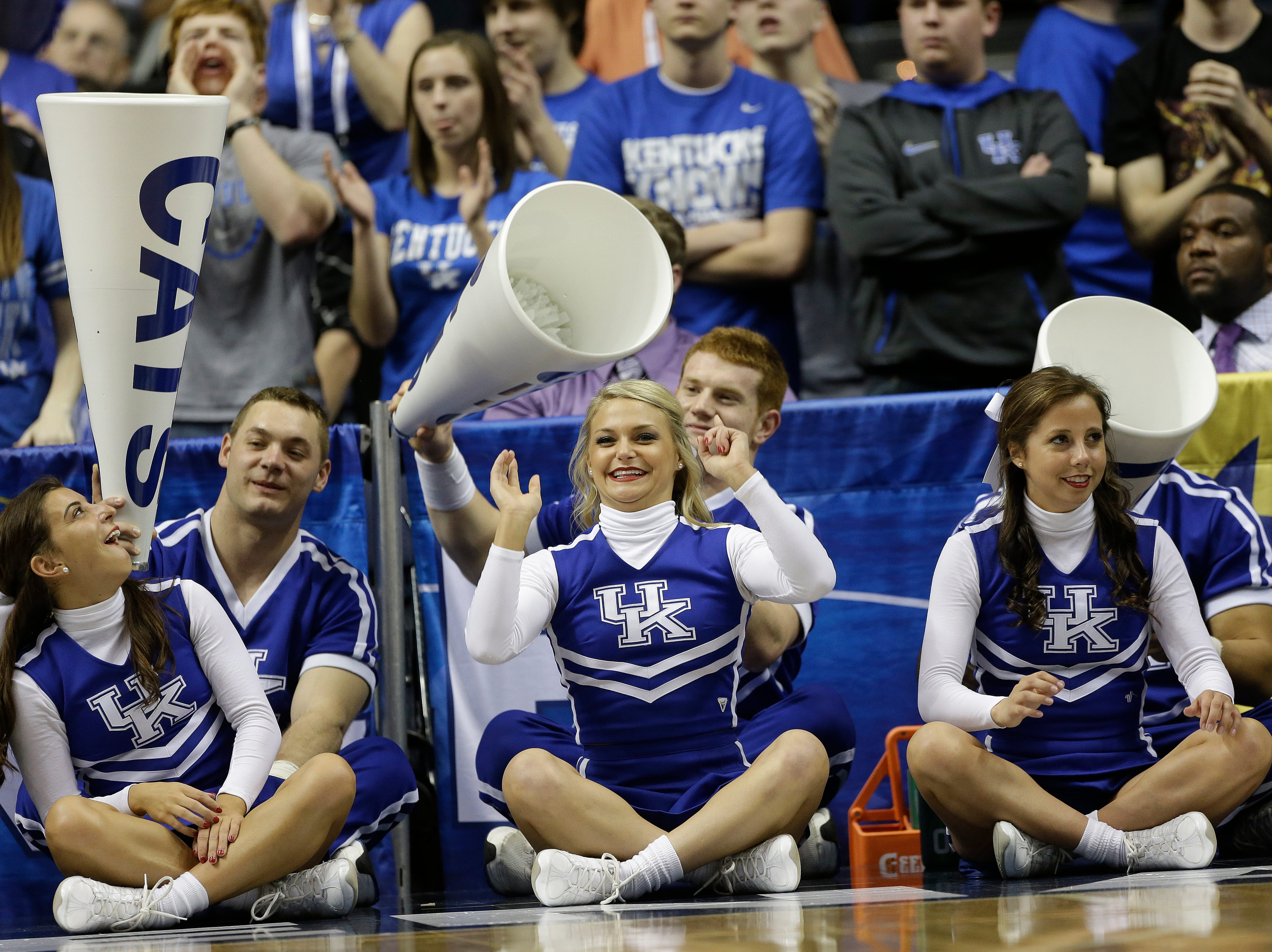 Kentucky  cheerleaders perform during the second half of an NCAA college basketball game against the Vanderbilt at the Southeastern Conference tournament, Friday, March 15, 2013, in Nashville, Tenn. (AP Photo/Dave Martin)