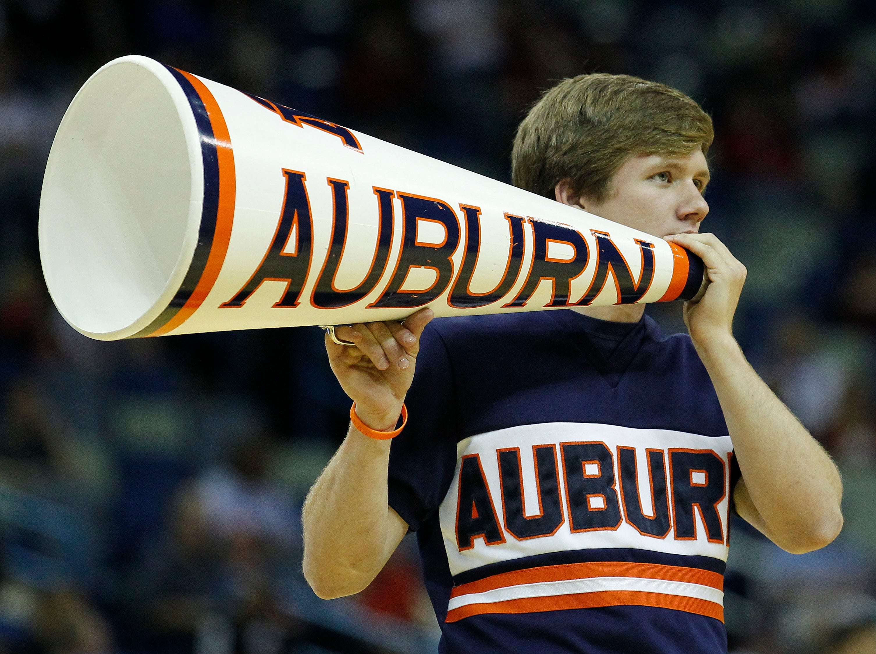 An Auburn cheerleader performs during the first half of an NCAA college basketball game in the first round of the 2012 Southeastern Conference tournament at the New Orleans Arena in New Orleans, Thursday, March 8, 2012. (AP Photo/Bill Haber)