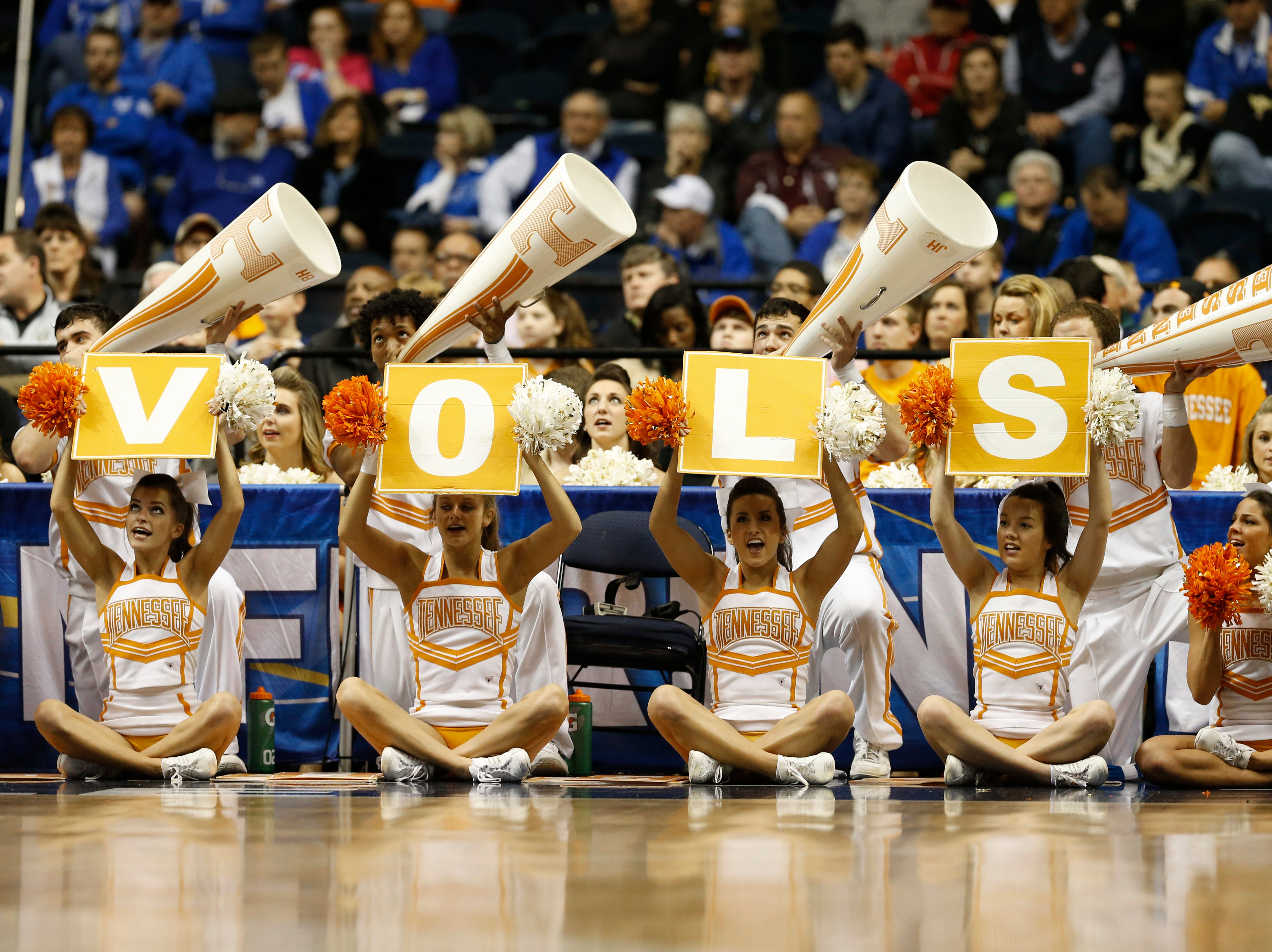 Tennessee cheerleaders perform during the second half of an NCAA college basketball game in the second round of the Southeastern Conference tournament between Tennessee and Vanderbilt, Thursday, March 12, 2015, in Nashville, Tenn. (AP Photo/Steve Helber)
