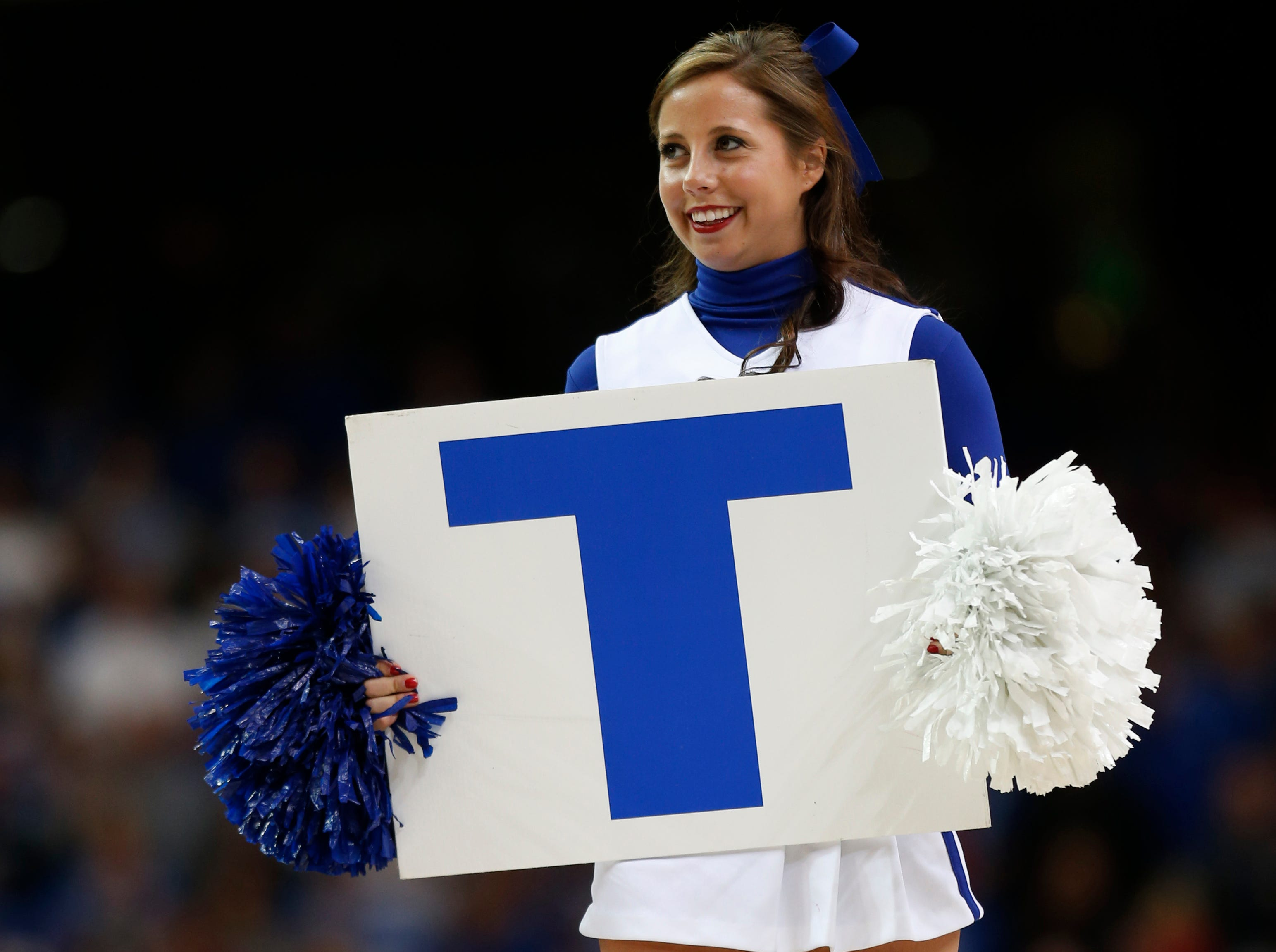 Kentucky cheerleaders perform during the first half of an NCAA college basketball game against Georgia in the semifinal round of the Southeastern Conference men's tournament, Saturday, March 15, 2014, in Atlanta. (AP Photo/John Bazemore)