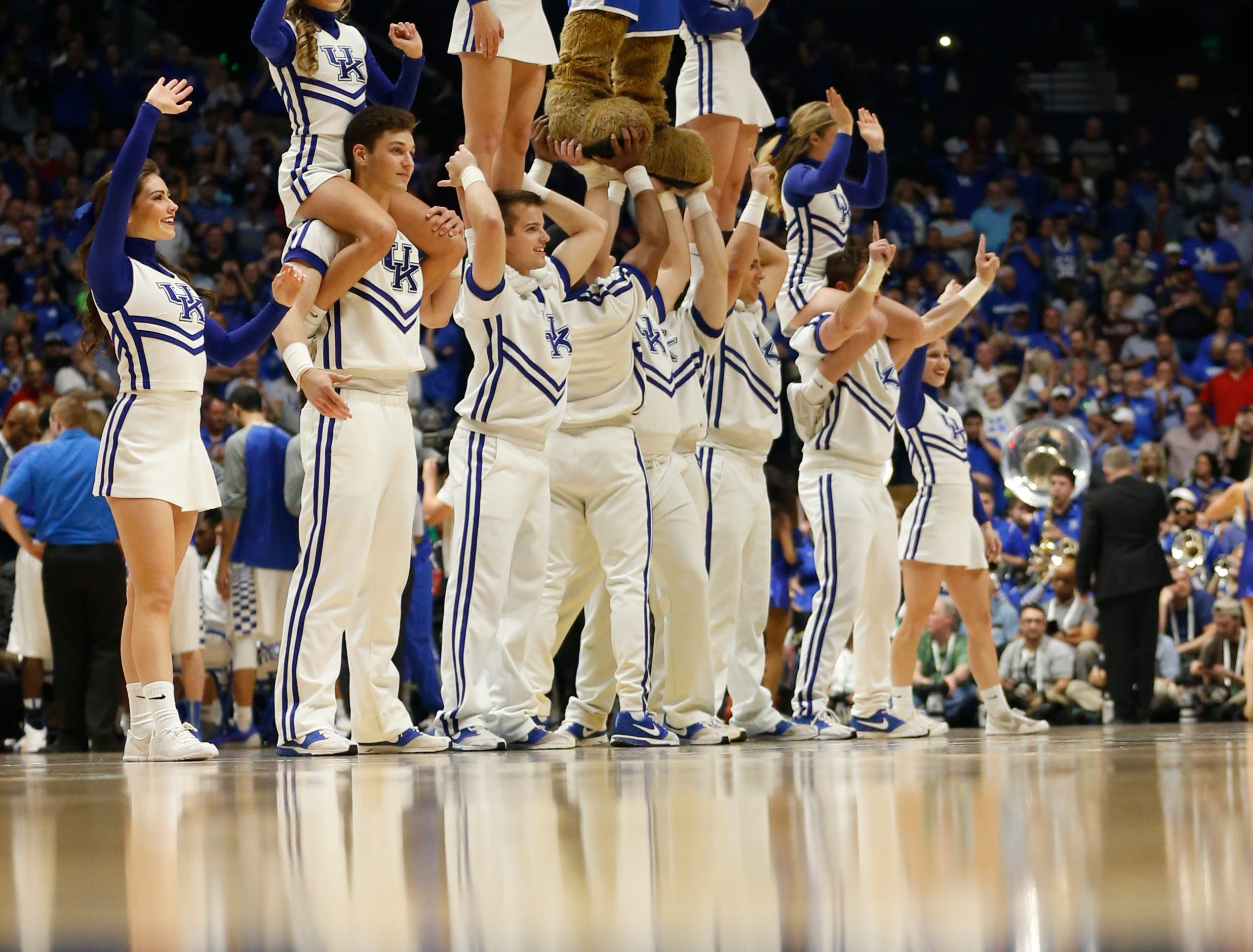 Kentucky cheerleaders perform during the second half of an NCAA college basketball game against Georgia in the Southeastern Conference tournament in Nashville, Tenn., Saturday, March 12, 2016. Kentucky won 93-80. (AP Photo/John Bazemore)