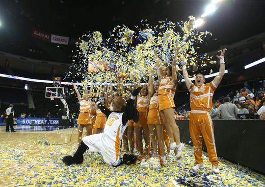 Tennessee mascot Smokey and cheerleaders throw up confetti after Tennessee defeated Kentucky in the finals of the Women's Southeastern Conference NCAA college basketball game, Sunday, March 9, 2014, in Duluth, Ga. Tennessee defeated Kentucky 71-70. (AP Photo/Jason Getz)