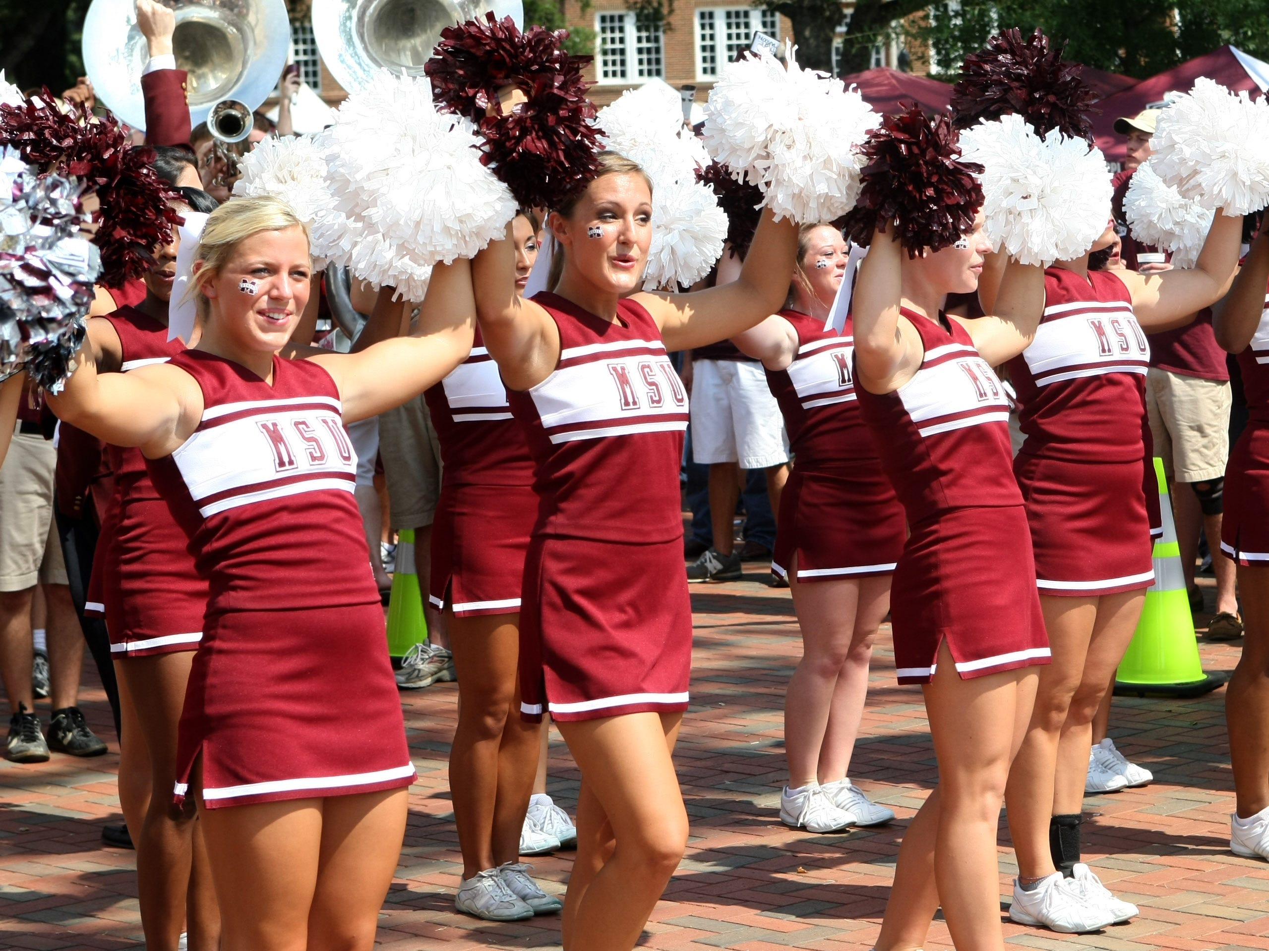 "Mississippi State cheerleaders form the 'U' of the ""We are MSU"" cheer before their NCAA college football game against Auburn in Starkville, Miss., at Davis Wade Stadium Saturday Sept. 9, 2010. (AP Photo/Kerry Smith)"