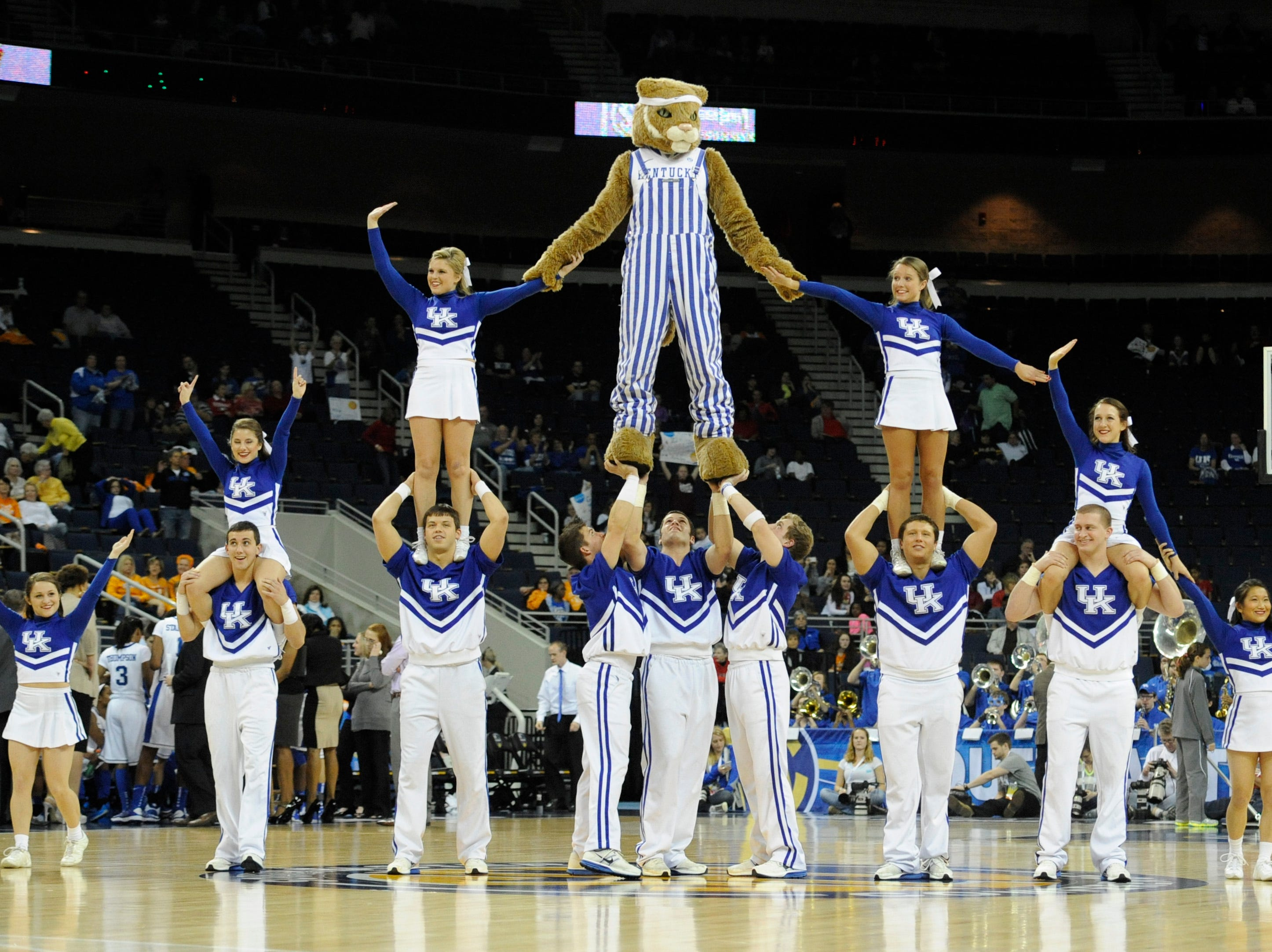 Kentucky cheerleaders perform during the second half of a NCAA college basketball game against Georgia in the Southeastern Conference tournament, Saturday, March 9, 2013, in Duluth, Ga. Kentucky won 60-38. (AP Photo/John Amis)