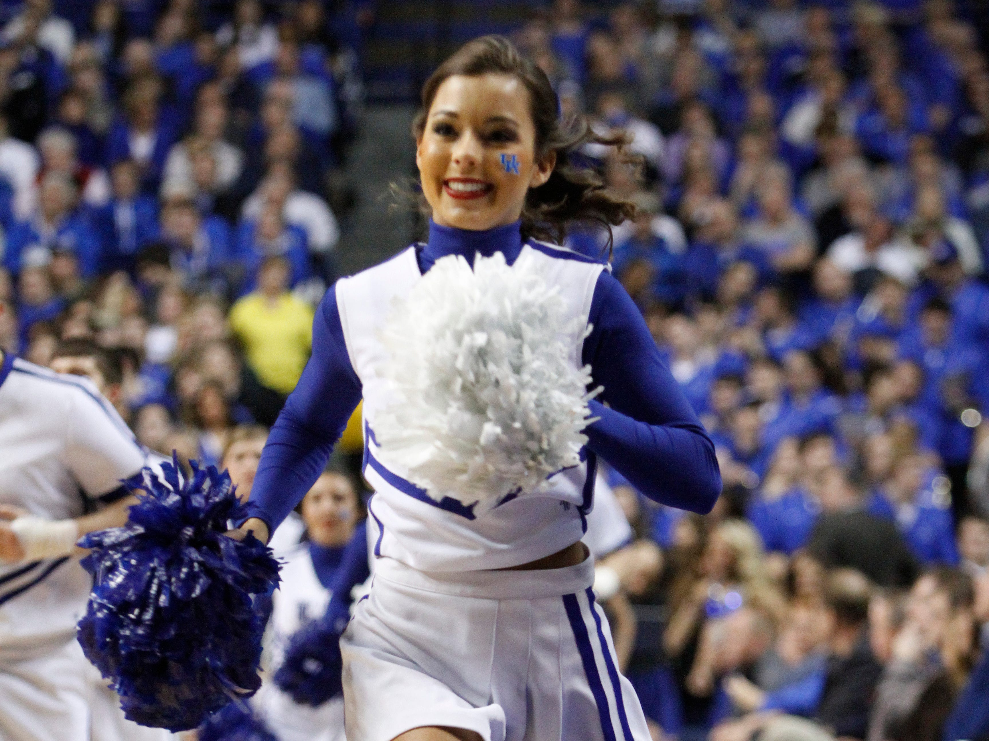 Kentucky cheerleaders perform during the second half of an NCAA college basketball game, Tuesday, March 4, 2014, in Lexington, Ky. Kentucky won 55-48. (AP Photo/James Crisp)