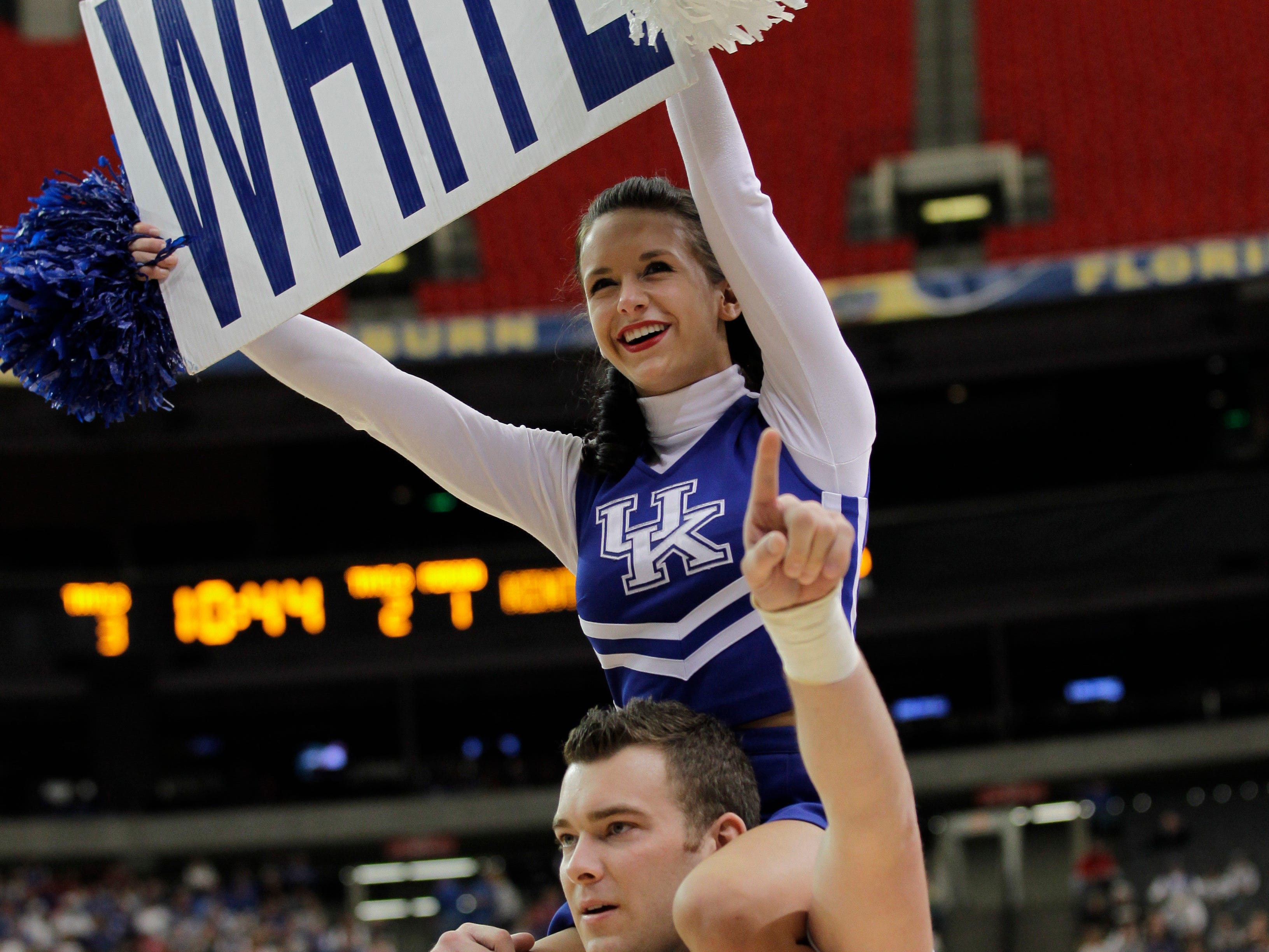Kentucky cheerleaders performs during the first half of an NCAA college basketball game against Alabama at the Southeastern Conference tournament, Saturday, March 12, 2011, in Atlanta.  (AP Photo/Dave Martin)