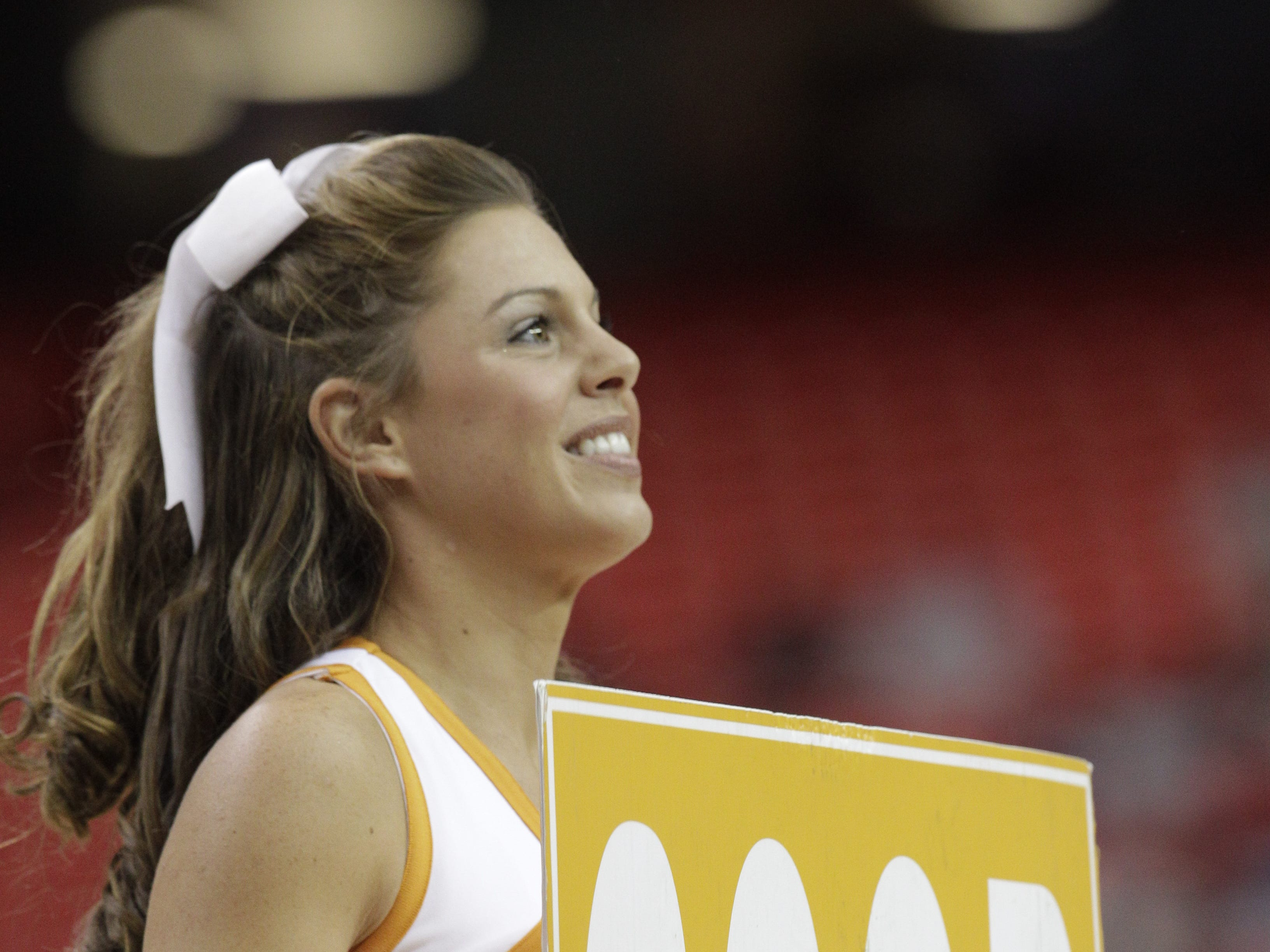 Tennessee cheerleaders perform against Florida during the first half of an NCAA college basketball game in the semifinal round of the Southeastern Conference men's tournament, Saturday, March 15, 2014, in Atlanta. (AP Photo/Steve Helber)