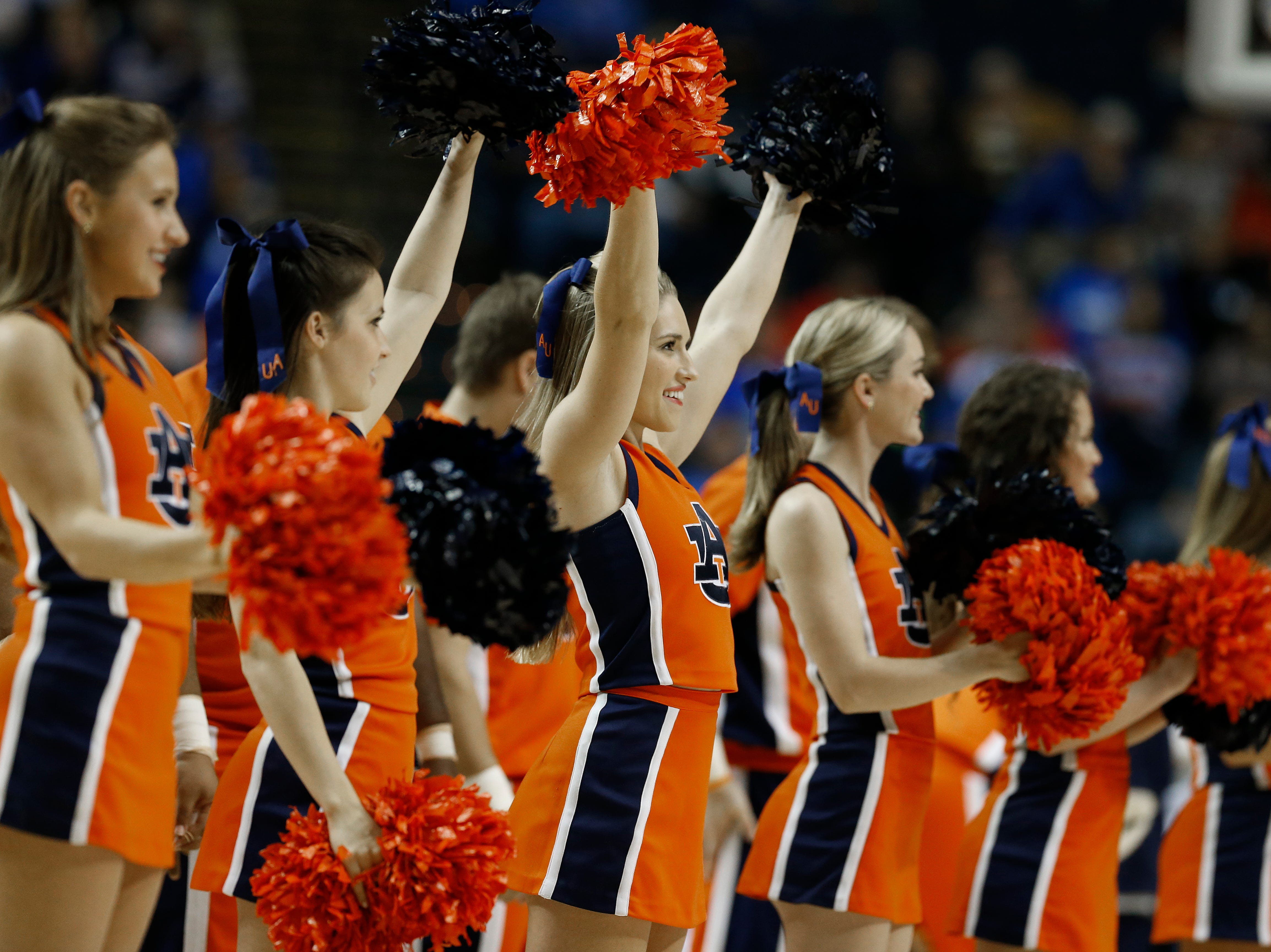 Auburn cheerleaders perform during the first half of an NCAA college basketball game in the second round of the Southeastern Conference tournament between Texas A&M and Auburn, Thursday, March 12, 2015, in Nashville, Tenn.  (AP Photo/Steve Helber)