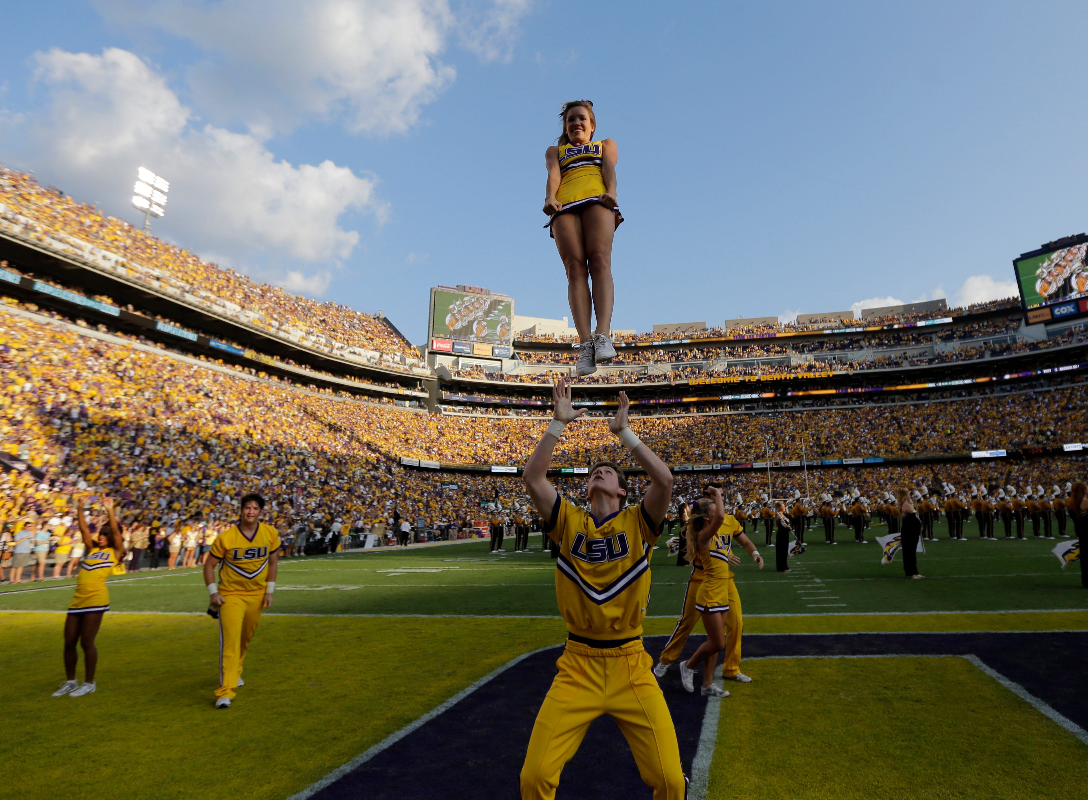 LSU cheerleaders perform before an NCAA college football game against Mississippi State in Baton Rouge, La., Saturday, Sept. 20, 2014. (AP Photo/Gerald Herbert)