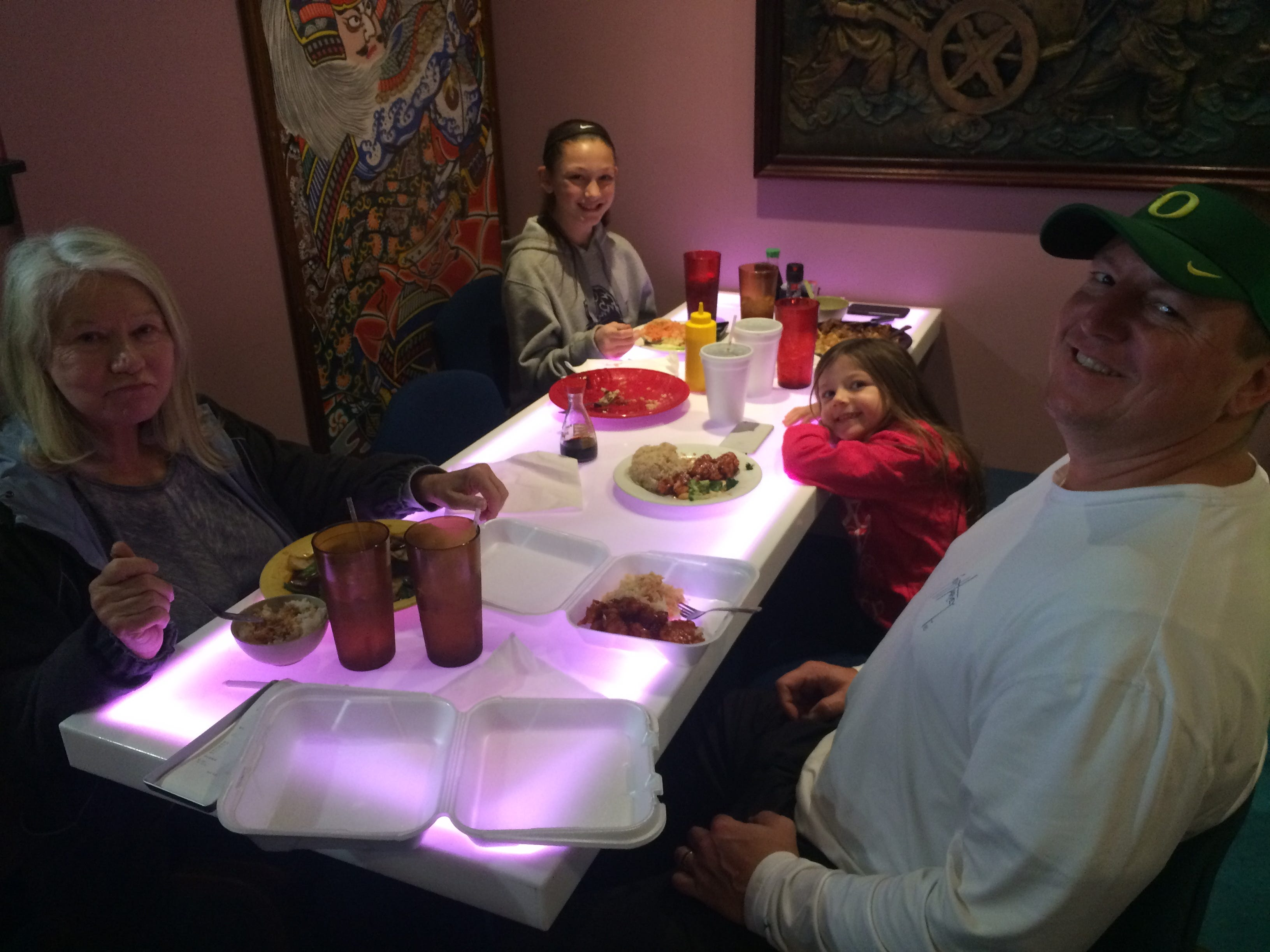 Powell High football coach Matt Lowe enjoys a meal at the Asia Café with his family: Sue Kitts, Lizzi Lowe and Linni Lowe.
