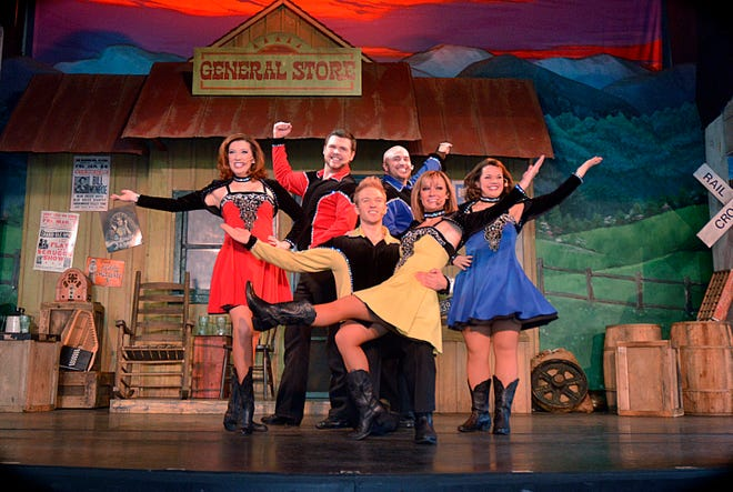 Performers pose during a show at Dollywood.