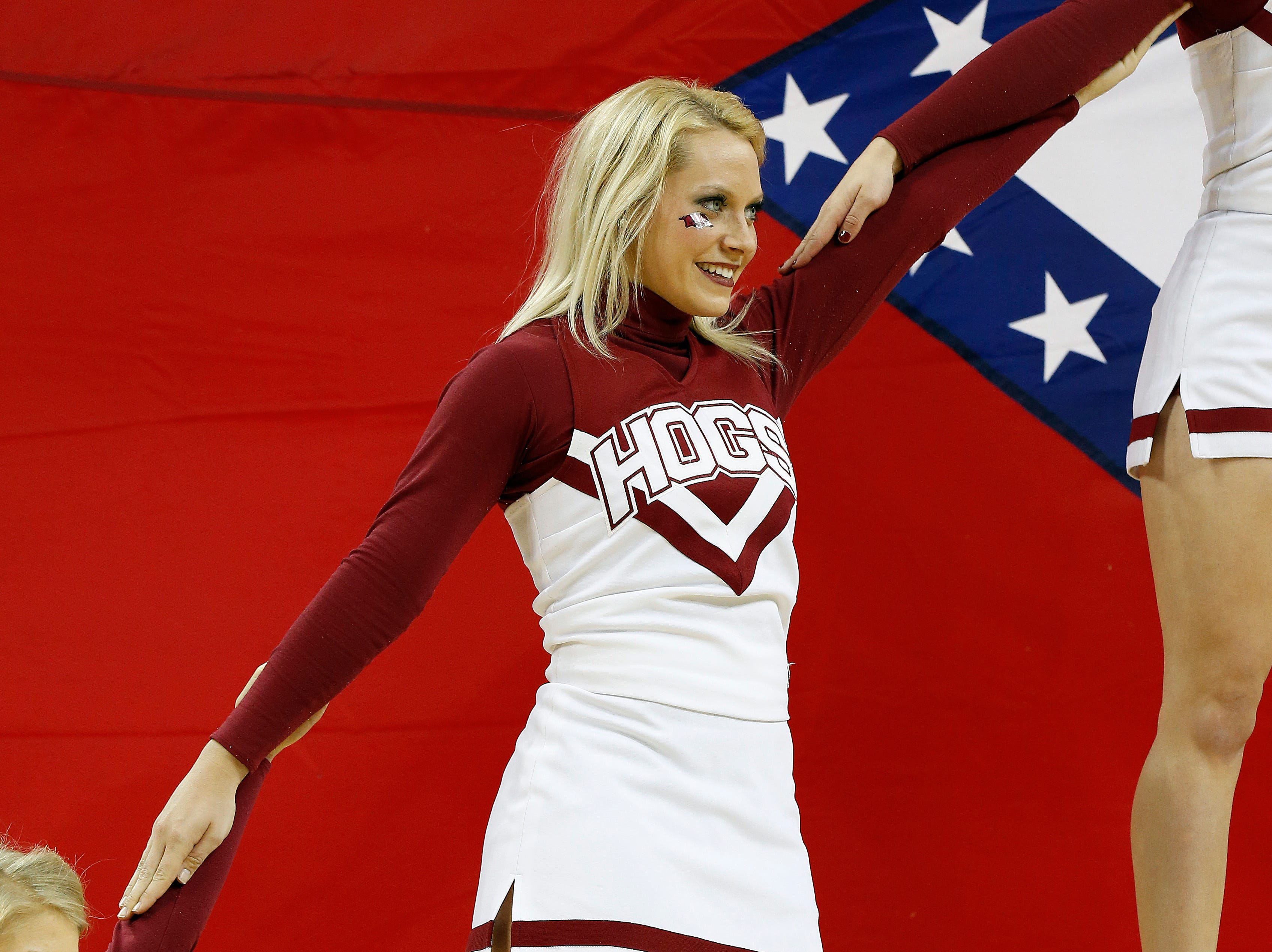 Arkansas cheerleaders preform in the first half of a first-round women's Southeastern Conference tournament NCAA college basketball game against Mississippi Wednesday, March 5, 2014, in Duluth, Ga.  Mississippi won 63-62. (AP Photo/John Bazemore