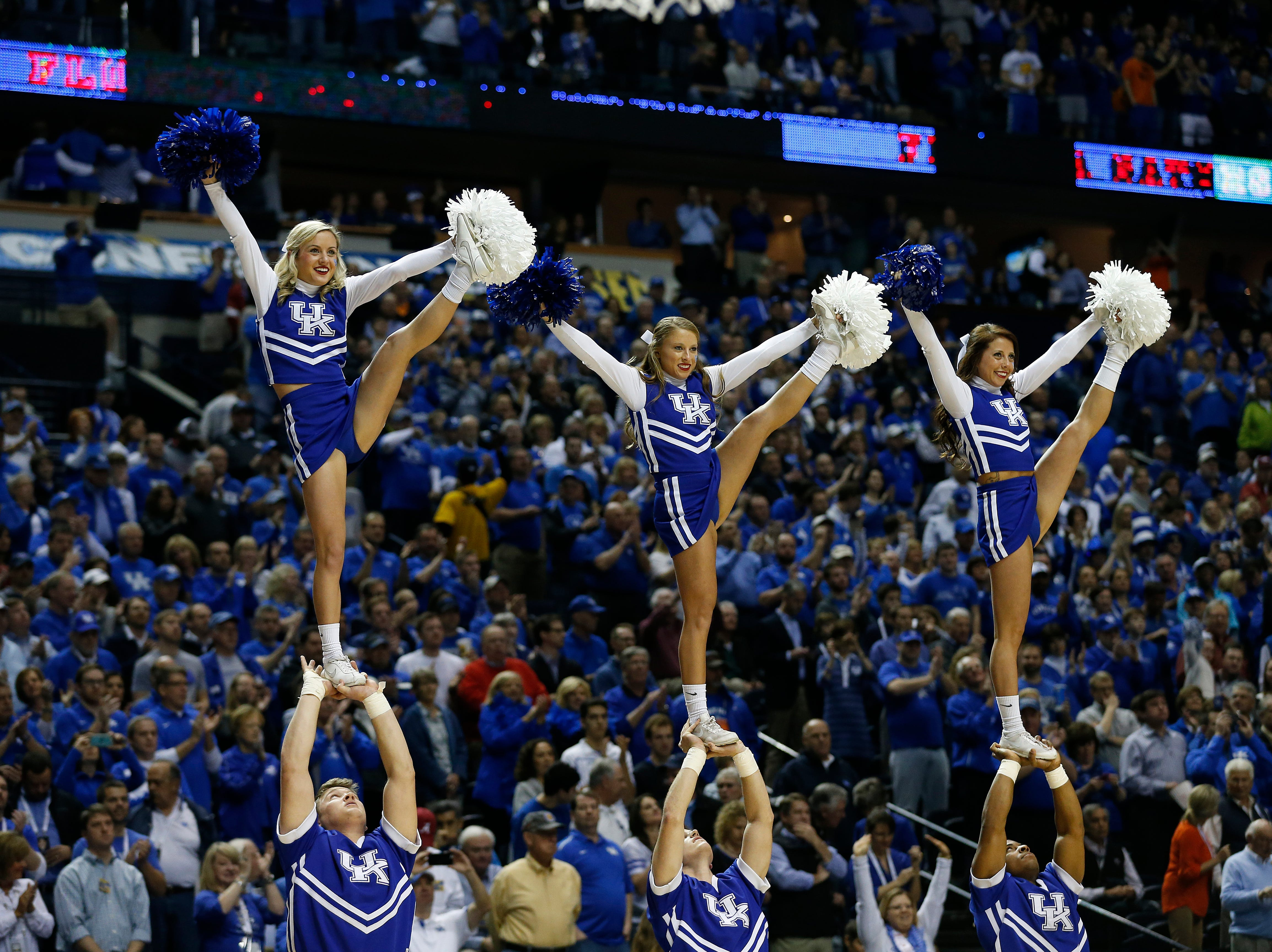 Kentucky cheerleaders perform during the first half of an NCAA college basketball game in the quarter final round of the Southeastern Conference tournament between Kentucky and Florida, Friday, March 13, 2015, in Nashville, Tenn. (AP Photo/Steve Helber)