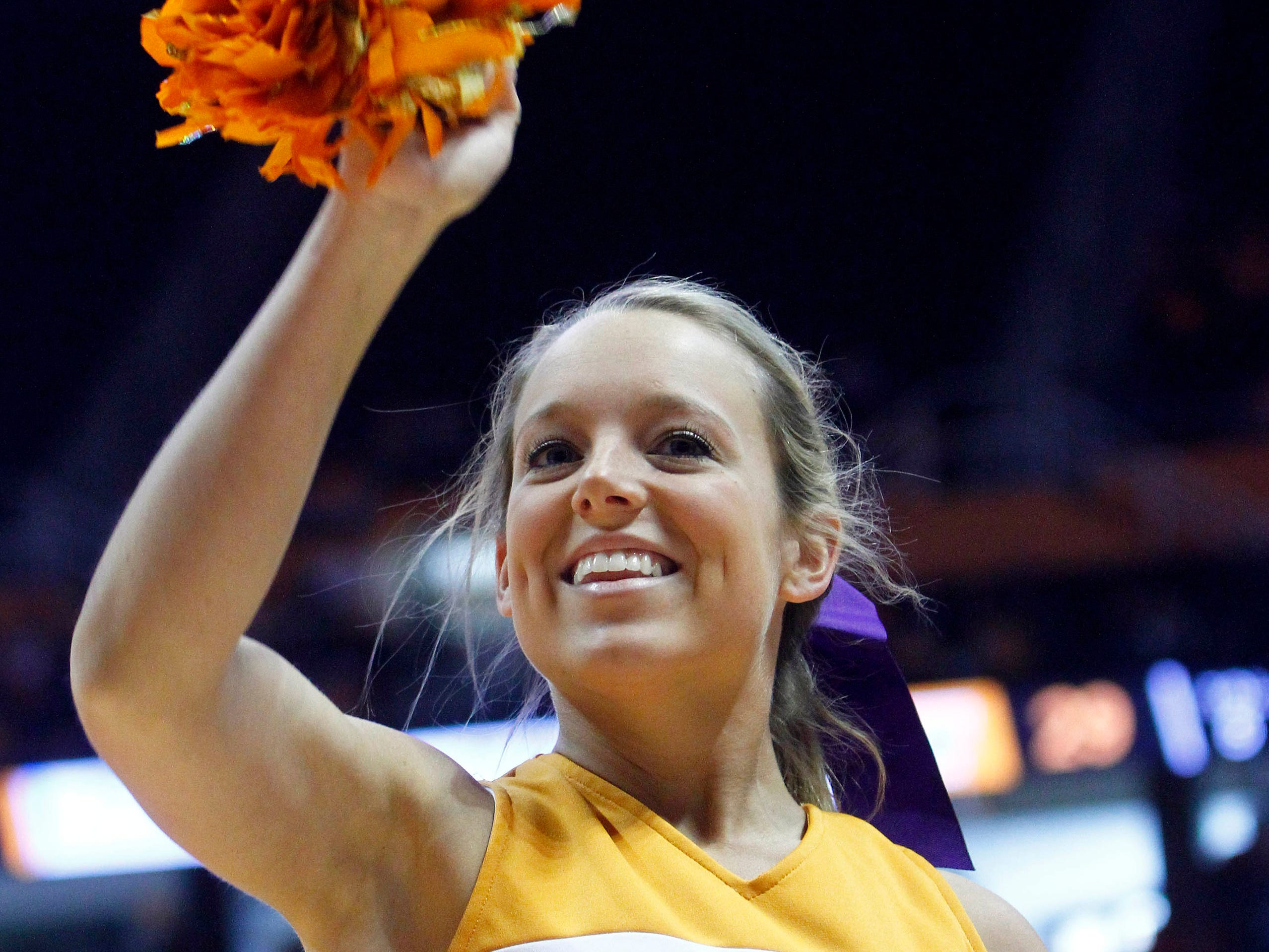 A Tennessee cheerleader performs during an NCAA college basketball game between Tennessee and Alabama on Sunday, Jan. 20, 2013, in Knoxville, Tenn. (AP Photo/Wade Payne)